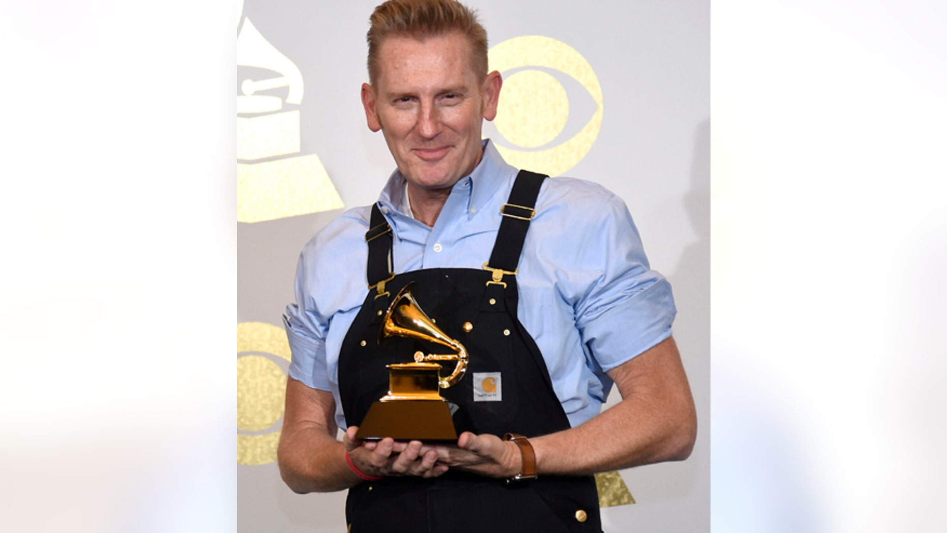 "Rory Lee Feek, of Joey + Rory, poses in the press room with the award for best roots gospel album for ""Hymns"" at the 59th annual Grammy Awards at the Staples Center on Sunday, Feb. 12, 2017, in Los Angeles. (Photo by Chris Pizzello/Invision/AP)"