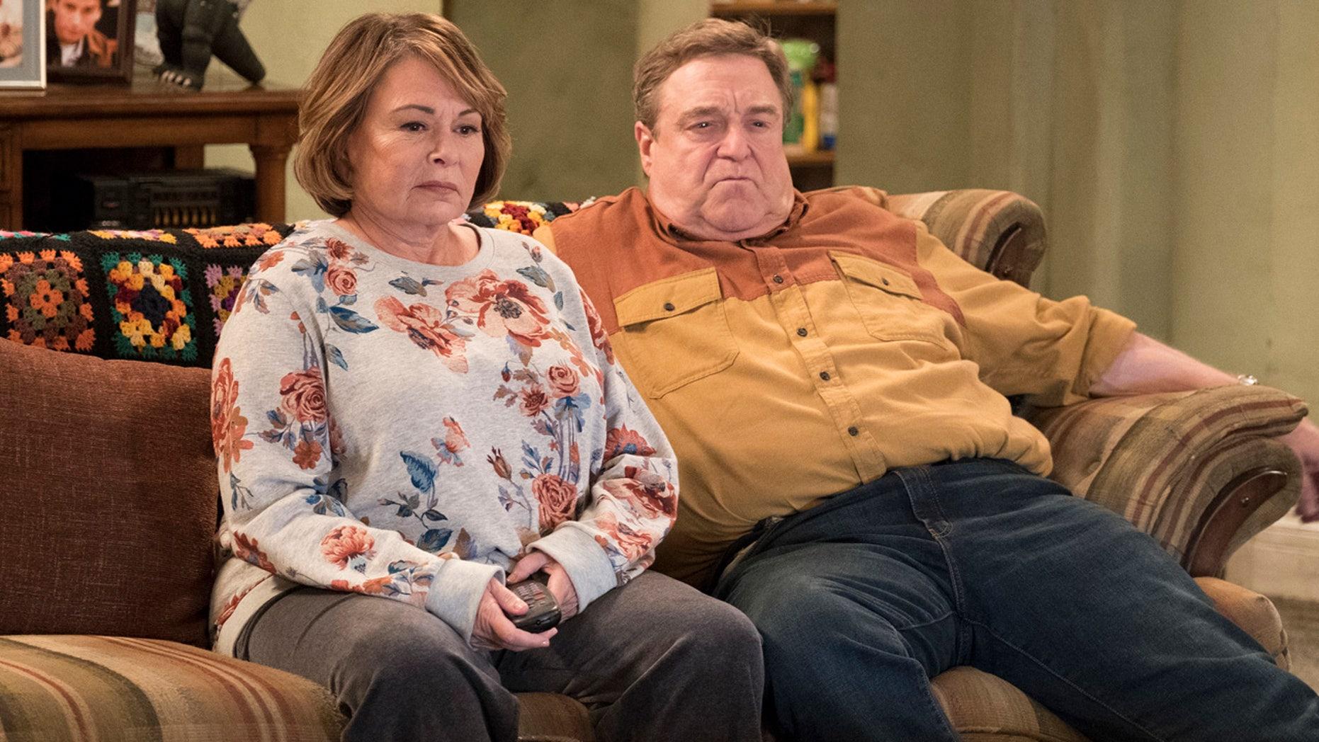 "Roseanne Barr, left, and John Goodman appear in a scene from the reboot of ""Roseanne."""