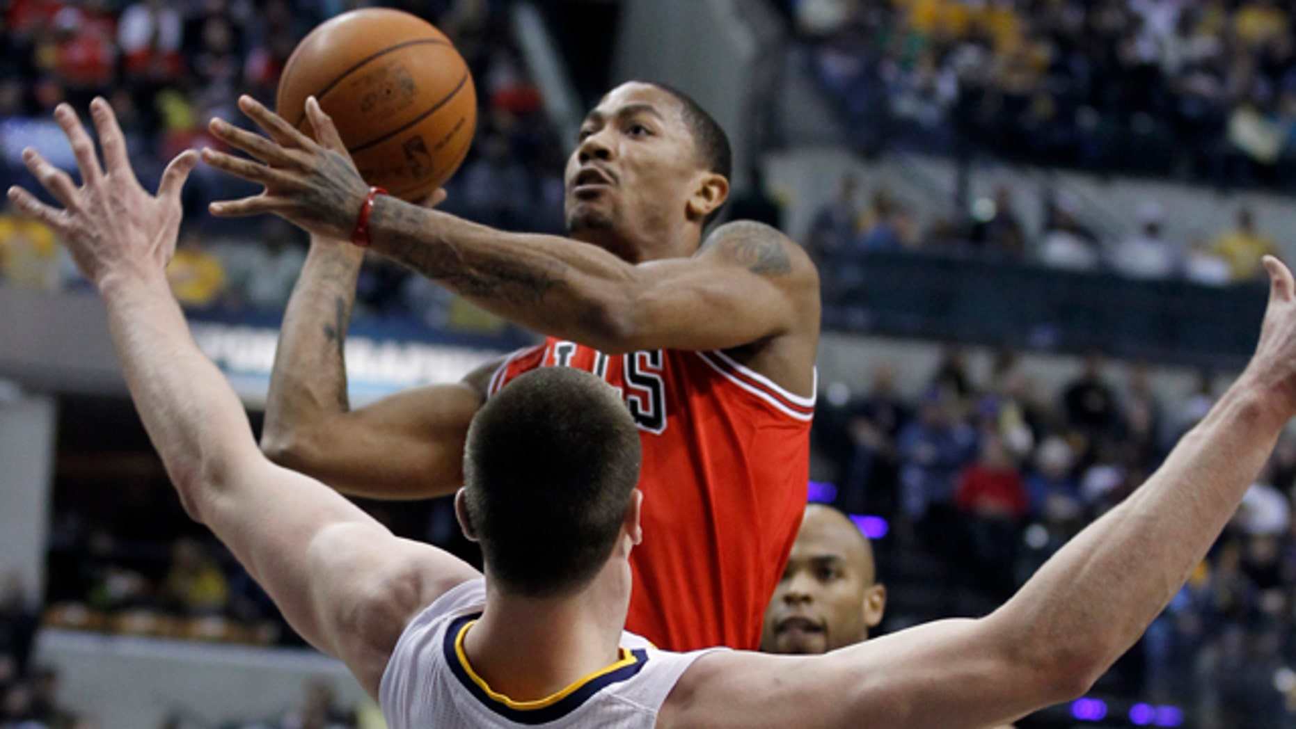 April 12: Indiana Pacers' Tyler Hansbrough (50) tries to draw a charging foul as Chicago Bulls' Derrick Rose drives to the basket during the first half of Game 3 of a first-round NBA basketball series in Indianapolis.