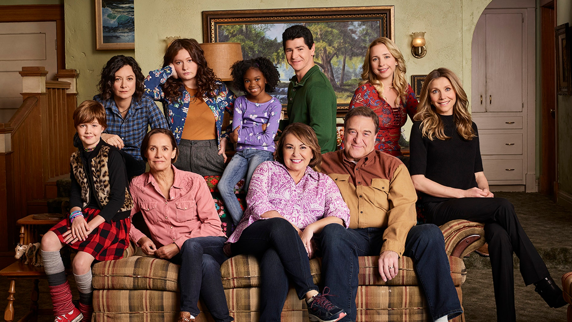 "ROSEANNE - ABC's ""Roseanne"" stars Ames McNamara as Mark, Sara Gilbert as Darlene Conner, Laurie Metcalf as Jackie Harris, Emma Kenney as Harris Conner, Jayden Rey as Mary, Roseanne Barr as Roseanne Conner, Michael Fishman as D.J. Conner, John Goodman as Dan Conner, Lecy Goranson as Becky Conner, and Sarah Chalke as Andrea. (ABC/Robert Trachtenberg)"