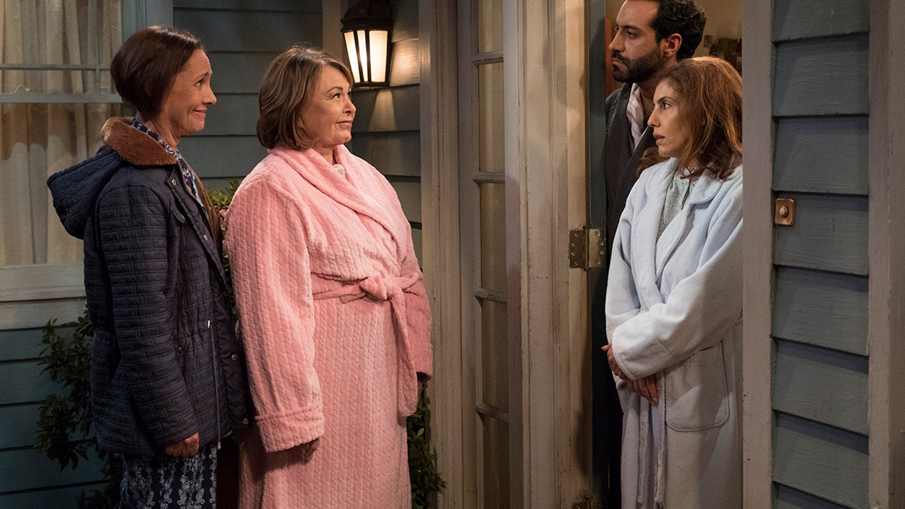 """ROSEANNE - """"Go Cubs"""" - The Conners can't pay their Wi-Fi bill, so they befriend their new neighbors to use the internet for Mary to Skype with mom Geena, who is stationed in Afghanistan. Meanwhile, Dan loses an important job and D.J. admits post-military life has been hard, so they come up with a plan to make extra money, on the seventh episode of the revival of """"Roseanne,"""" TUESDAY, MAY 8 (8:00-8:30 p.m. EDT), on The ABC Television Network. (ABC/Adam Rose)SARA GILBERT, ROSEANNE BARR, ALAIN WASHNEVSKY, ANNE BEDIAN"""