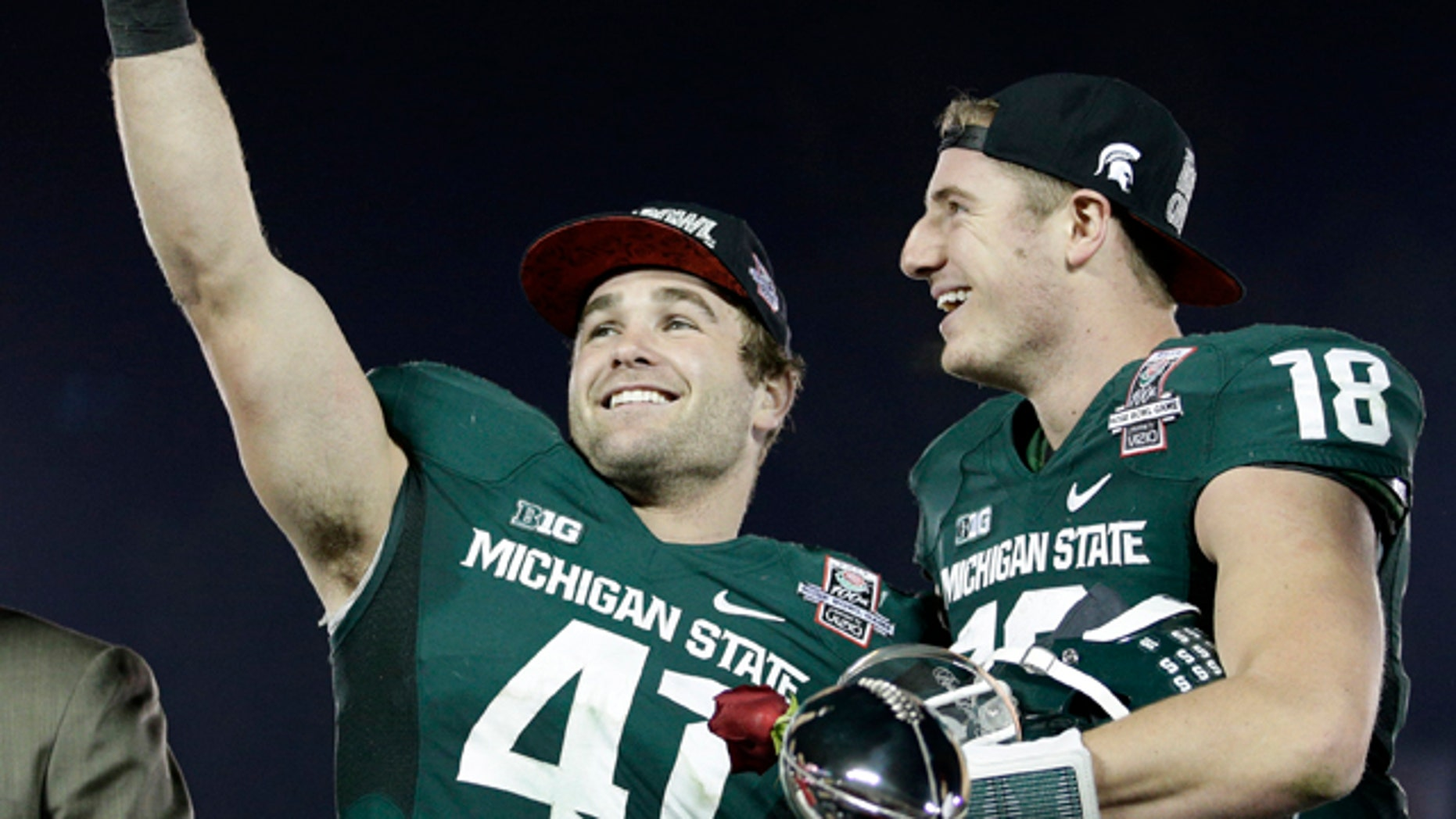 Jan. 1, 2014: Michigan State linebacker Kyler Elsworth, left, celebrates with quarterback Connor Cook after Michigan State defeated Stanford 24-20 in the Rose Bowl NCAA college football game.