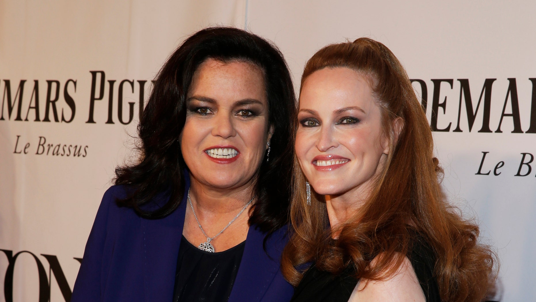 June 8, 2014. Rosie O'Donnell (L) and Michelle Rounds arrive for the 68th annual Tony Awards at Radio City Music Hall in New York.