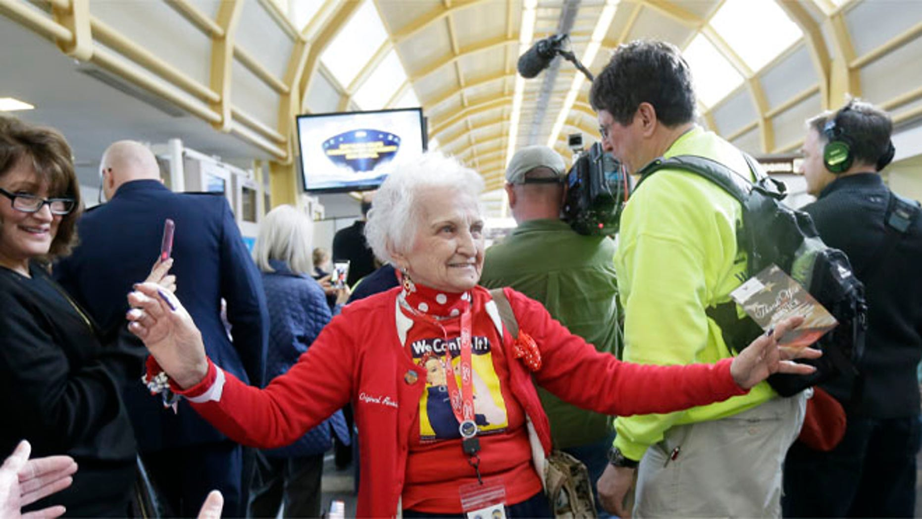 March 22, 2016: Former Rosie, Sylvia Tanis is greeted at the Ronald Reagan Washington National Airport.