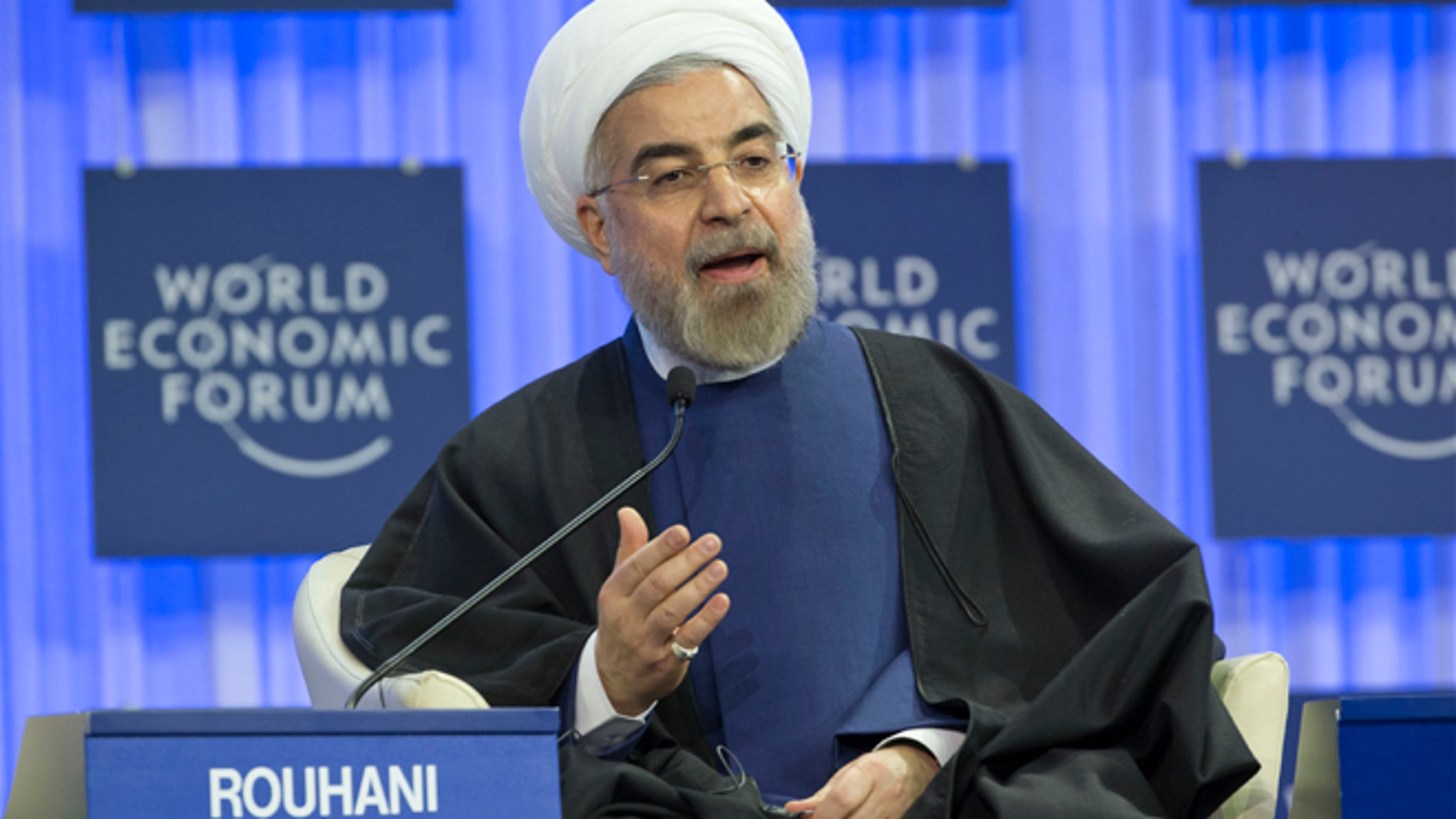 Jan. 23, 2014: Iranian President Hassan Rouhani gestures as speaks during a session of the World Economic Forum in Davos, Switzerland.