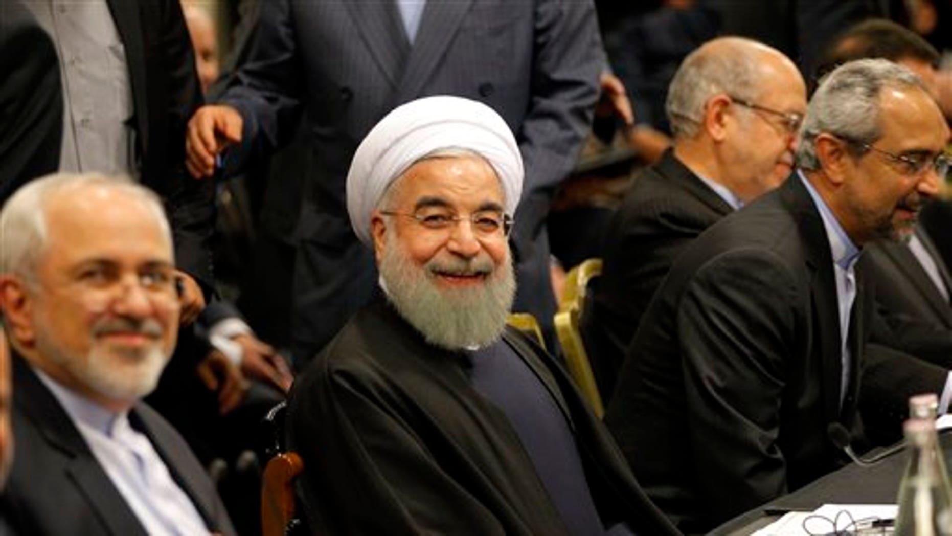 "Iranian President Hassan Rouhani smiles ahead of a meeting in Paris, Wednesday, Jan. 27, 2016. Rouhani says his first visit to Europe since the nuclear accord was signed has proven that there are ""great possibilities"" for economic, academic, scientific and cultural cooperation and that ""today we are in a win-win situation"" after years of mutual losses due to sanctions. (AP Photo/Christophe Ena)"