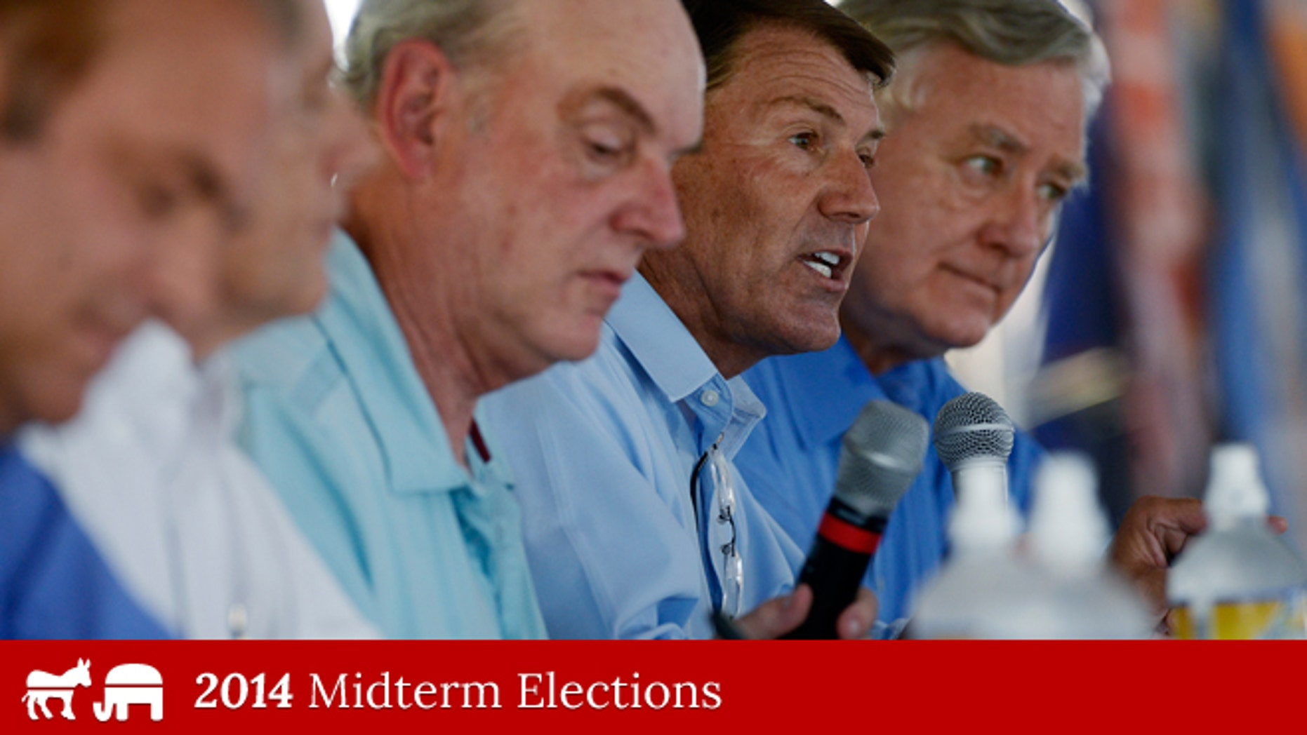 Aug. 27, 2014: South Dakota GOP Senate candidate Mike Rounds speaks while debating rivals Rick Weiland, Larry Pressler and Gordon Howie at Dakotafest in Mitchell, S.D.