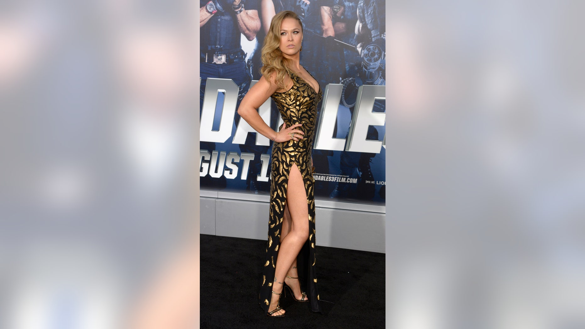 """Cast member Ronda Rousey attends the premiere of the film """"The Expendables 3"""" in Los Angeles August 11, 2014."""