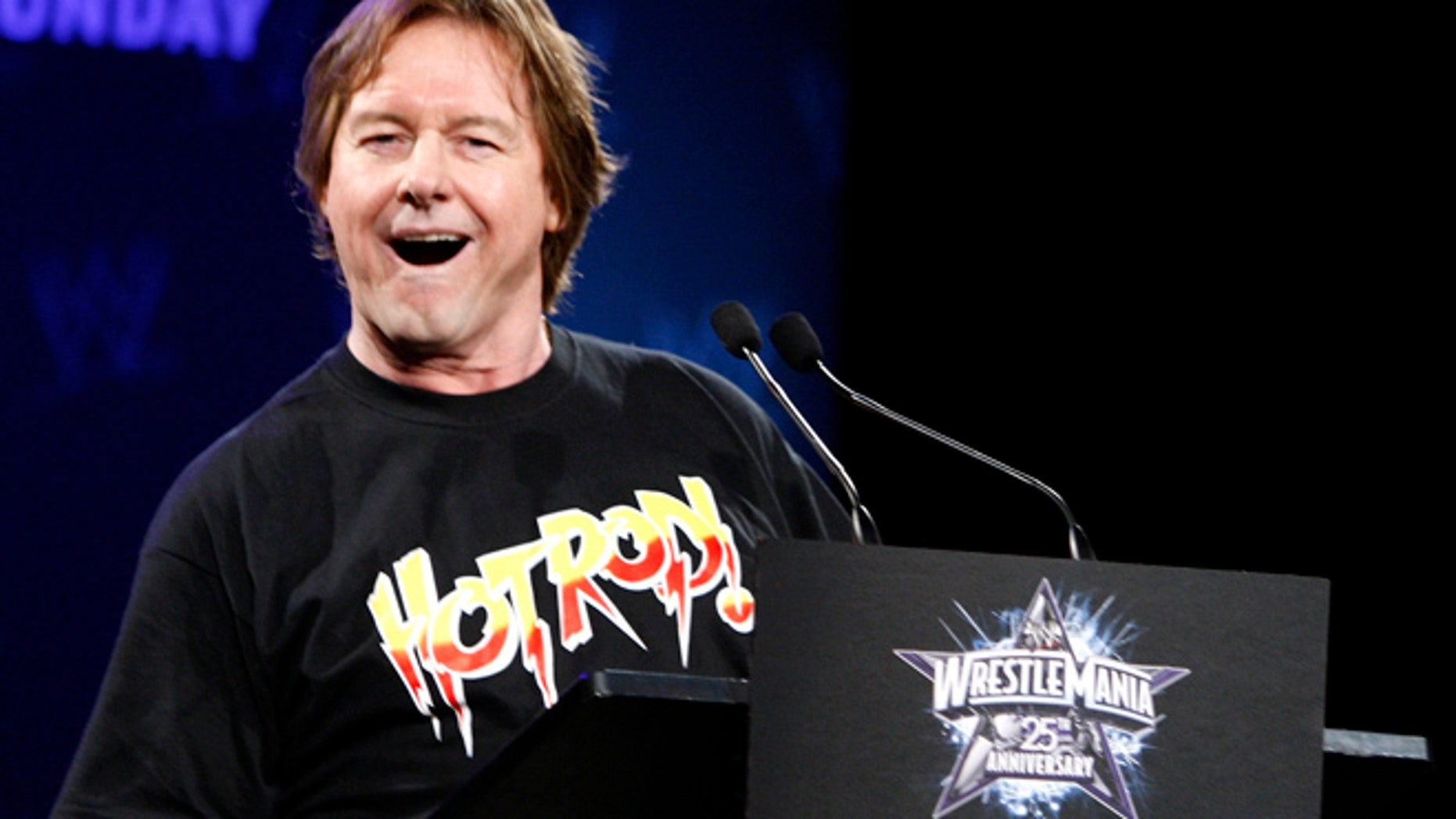"WWE Hall of Fame Wrestler ""Rowdy"" Roddy Piper speaks during a press conference for the 25th Anniversary of WrestleMania, as wrestler Chris Jericho (R) looks on in New York March 31, 2009. The 25th Anniversary of WrestleMania will take place at Reliant Stadium in Houston, Texas April 5.     REUTERS/Brendan McDermid (UNITED STATES) - RTXDGPP"
