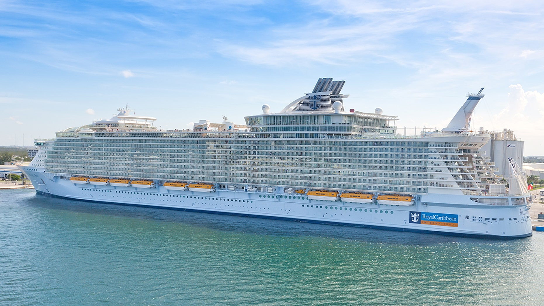 """""""Ft. Lauderdale, Florida, USA - July 10, 2011: Royal Caribbean's, Allure of the Seas, docked in Port Everglades.  The Allure of the Seas holds the record for the largest passenger ship ever constructed, just 2.0 in. longer than her sister ship, Oasis of the Seas."""""""