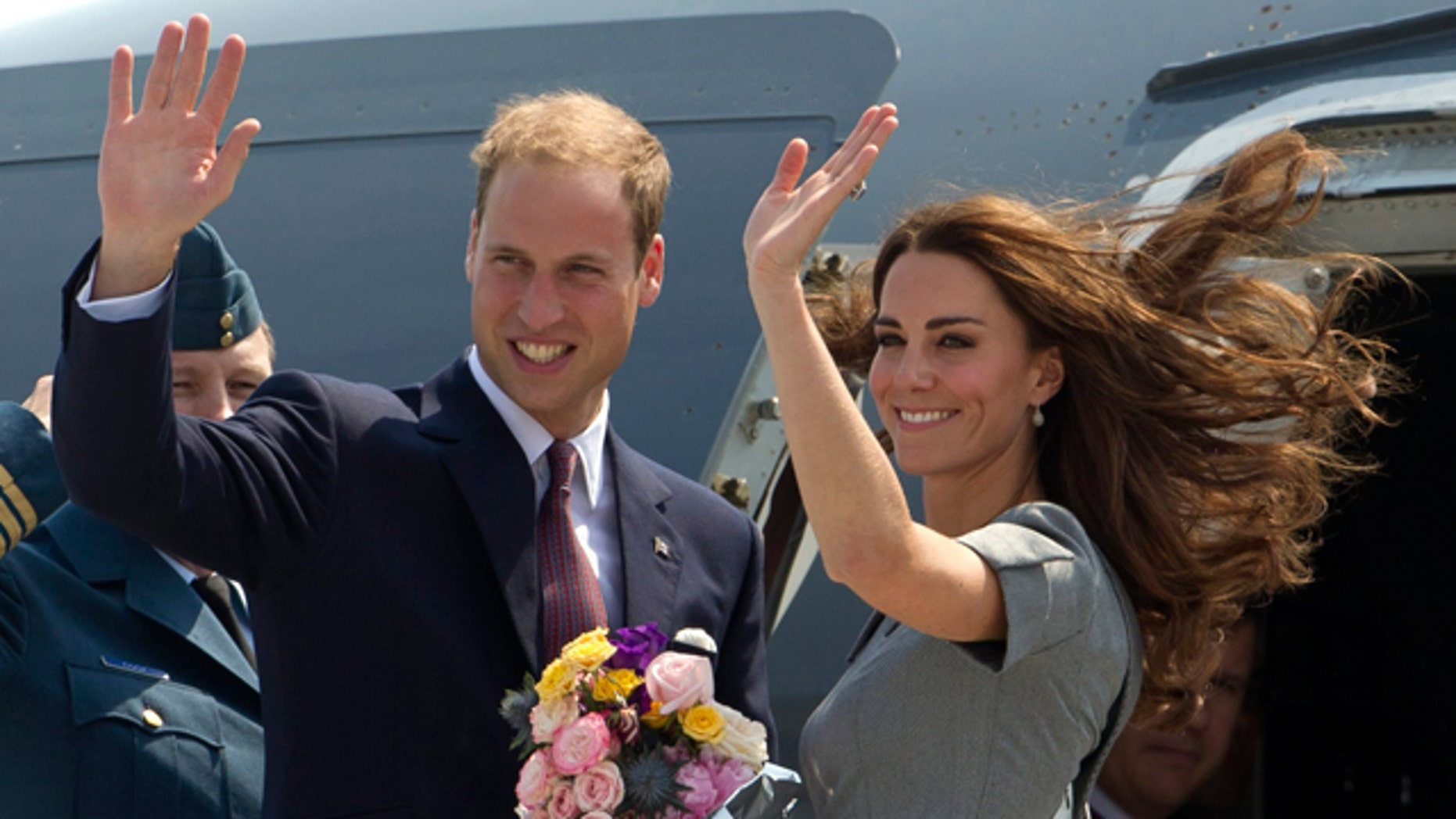 July 2: Prince William and Kate, the Duke and Duchess of Cambridge, wave as they board their plane as they leave Ottawa, Ontario , en route to Montreal as they continue their Royal Tour of Canada.