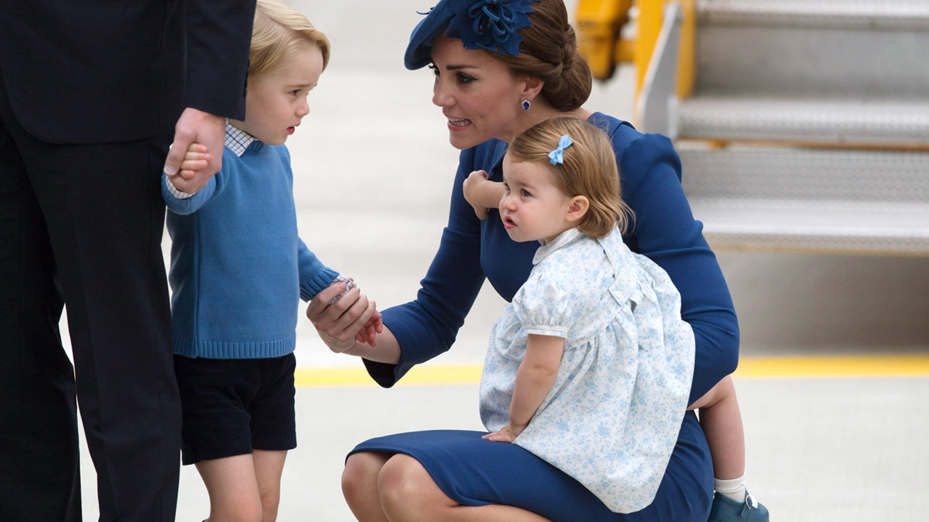 Sept. 24, 2016: Kate, the Duchess of Cambridge, holds her daughter Princess Charlotte as she speaks to her son Prince George as she and her husband Britain's Prince William, the Duke of Cambridge, arrive in Victoria, British Columbia.