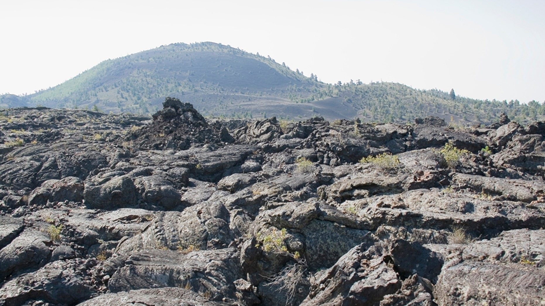 The vast ocean of lava flows through scattered islands of cinder cones and sagebrush at Idaho's space-like Craters of the Moon National Park.