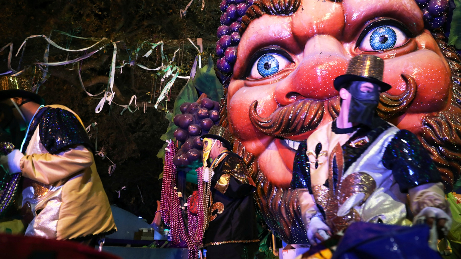 Float riders throw beads at the Bacchus parade during Mardi Gras in New Orleans, Feb. 26, 2017.