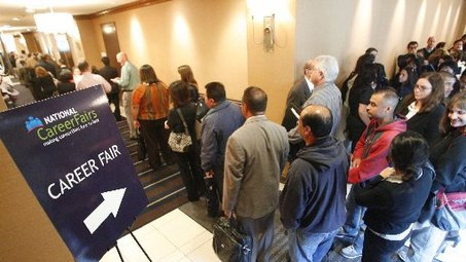 Job seekers line up for a career fair in Ahaheim, Calif.
