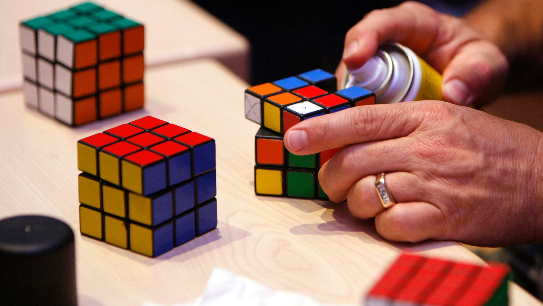 A competitor cleaning his Rubik's cube.