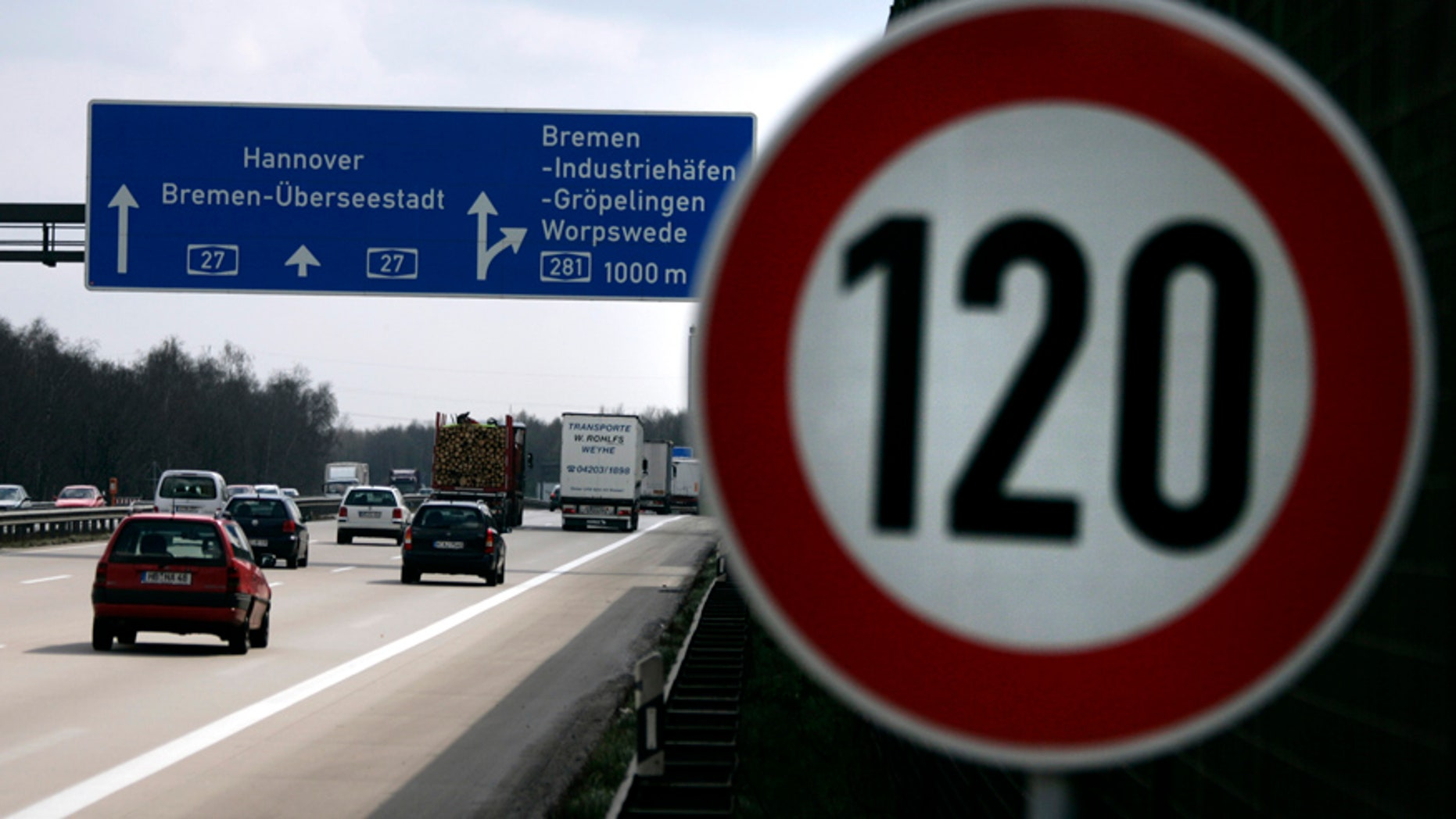 Cars pass a 120 km/h (75 mph) speed limit sign on the A27 Autobahn near the northern German city of Bremen April 10, 2008. The northern city of Bremen became Germany's first state to introduce a speed limit on its motorways on Wednesday, breaking a taboo in a country proud of its fast cars. REUTERS/Morris Mac Matzen  (GERMANY) - RTR1ZBNZ