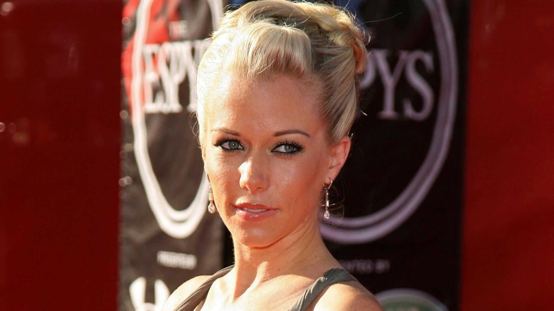 "Wilkinson rose to fame as one of Hugh Hefner's three live-in girlfriends on E!'s ""Girls Next Door"" before marrying Baskett in 2009."