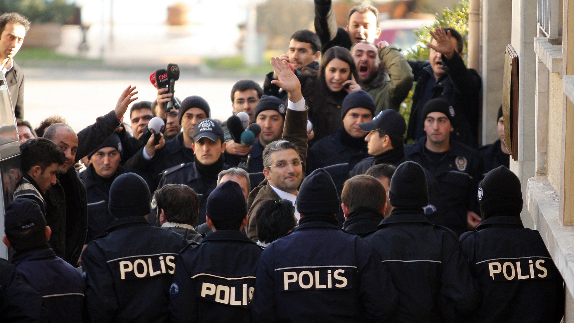 Ahmet Sik (facing camera, third from left) outside an Istanbul courthouse in 2011.