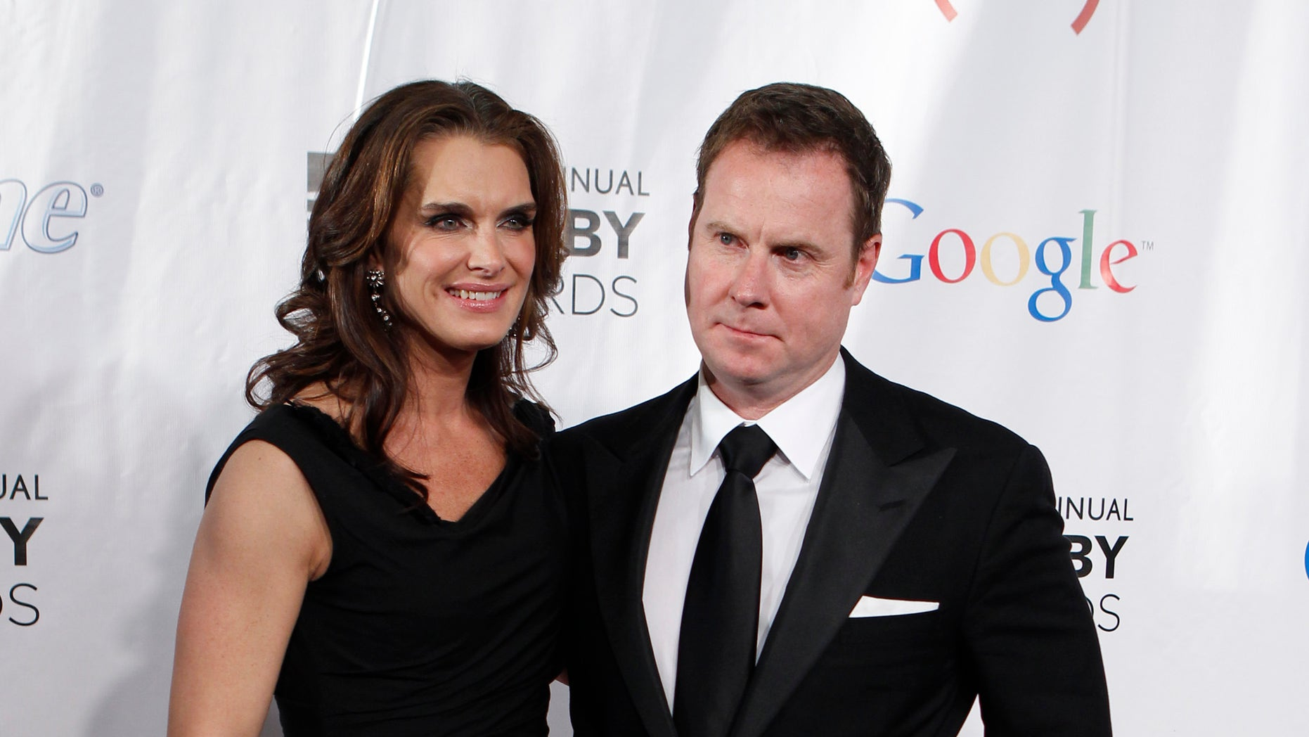 Actress Brooke Shields arrives with Chris Henchy at the 15th annual Webby Awards in New York June 13, 2011.  REUTERS/Lucas Jackson  (UNITED STATES - Tags: ENTERTAINMENT) - RTR2NN4D