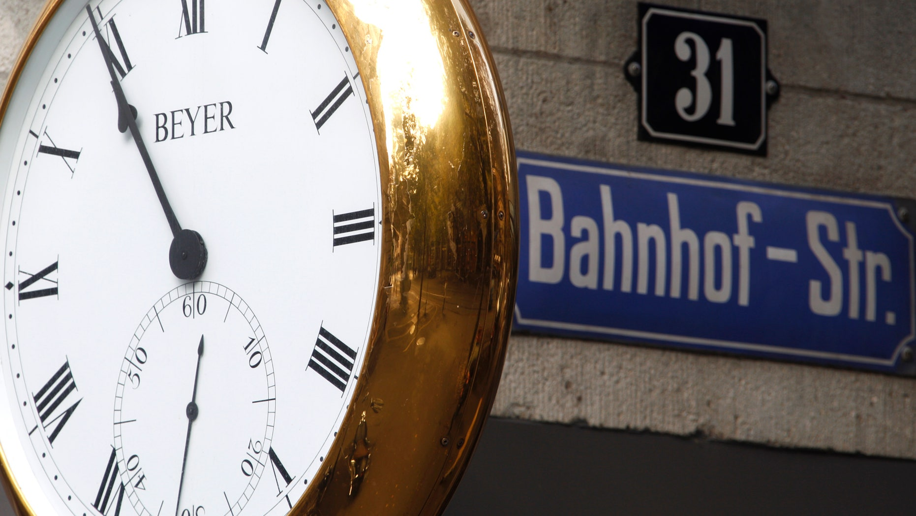 A clock displays the time on the facade of a jewellery and watch shop at Bahnhofstrasse in Zurich October 3, 2011.