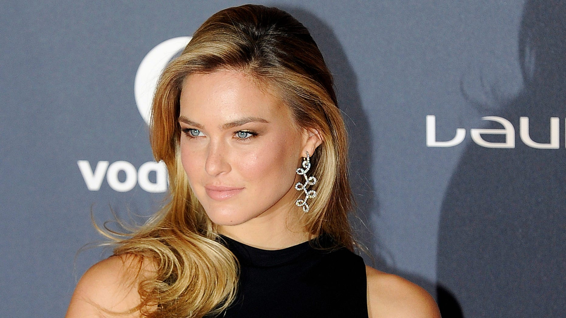 Model Bar Refaeli poses for photographs as she attends the 2012 Laureus World Sports Awards, central London, February 6, 2012.   REUTERS/Paul Hackett  (BRITAIN - Tags: ENTERTAINMENT SPORT) - RTR2XF99