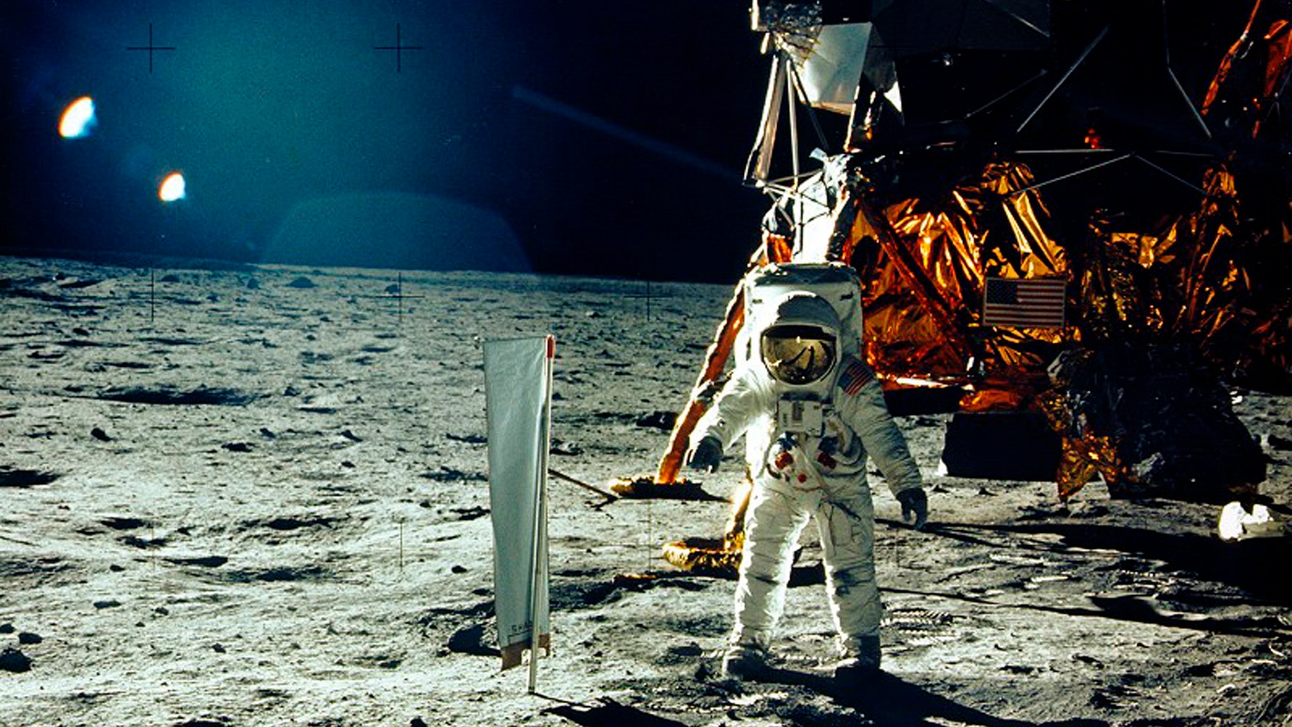 United States astronaut Buzz Aldrin stands beside a solar wind experiment next to the Lunar Module spacecraft on the surface of the Moon after he and fellow astronaut Neil Armstrong became the first men to land on the Moon during the Apollo 11 space mission July 20, 1969. (REUTERS/Neil Armstrong/NASA/Handout)