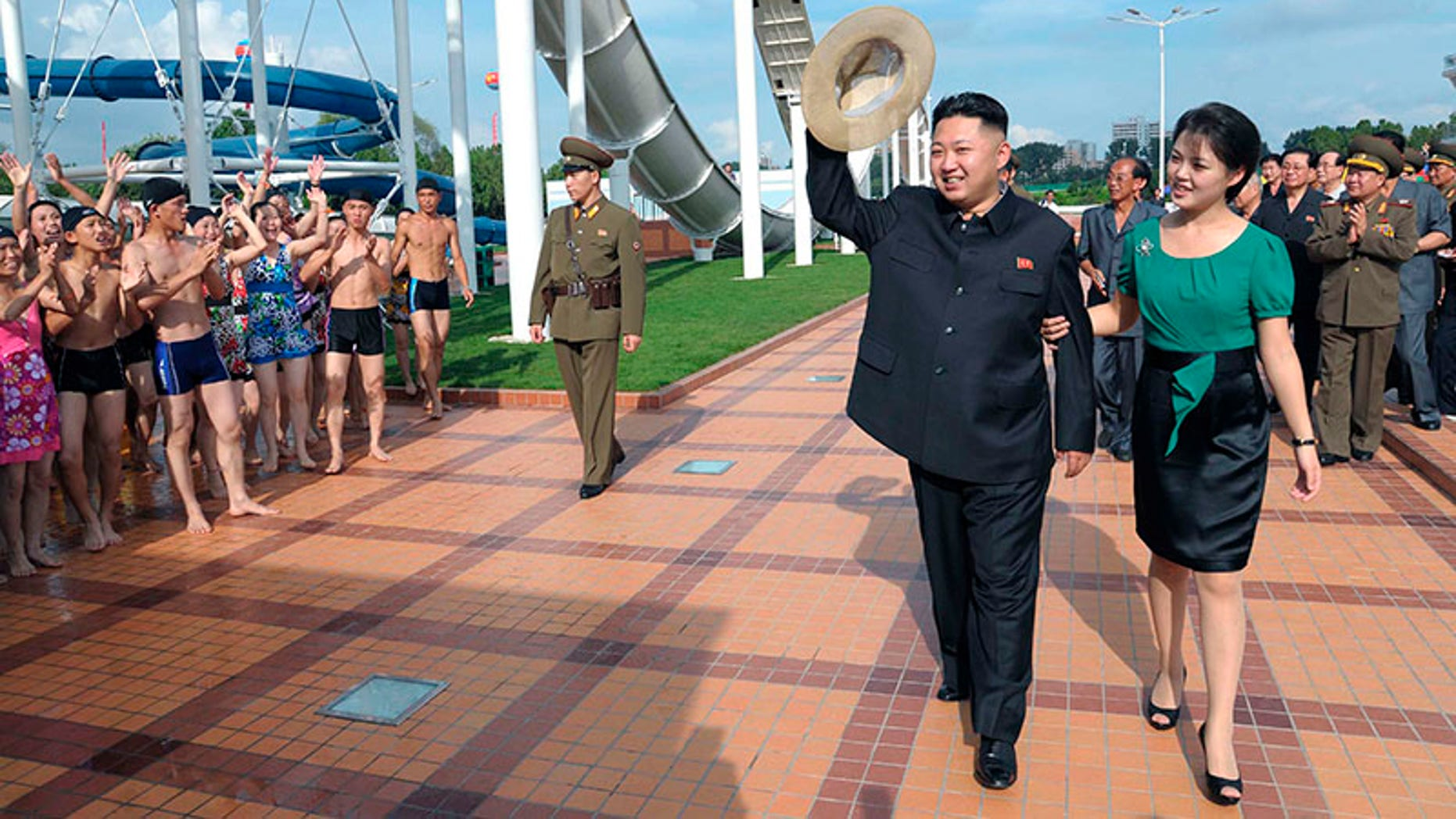 North Korean leader Kim Jong Un and his wife Ri Sol-ju attend the opening ceremony of the Rungna People's Pleasure Ground on Rungna Islet along the Taedong River in Pyongyang July 25, 2012. This photograph was released by the North's KCNA to Reuters on July 26, 2012.