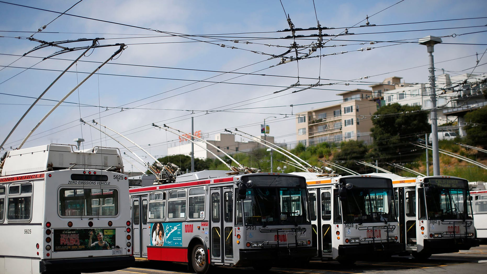 In this file photo, San Francisco Municipal Transit Agency buses are seen parked at the agency's Presidio Division office in San Francisco.