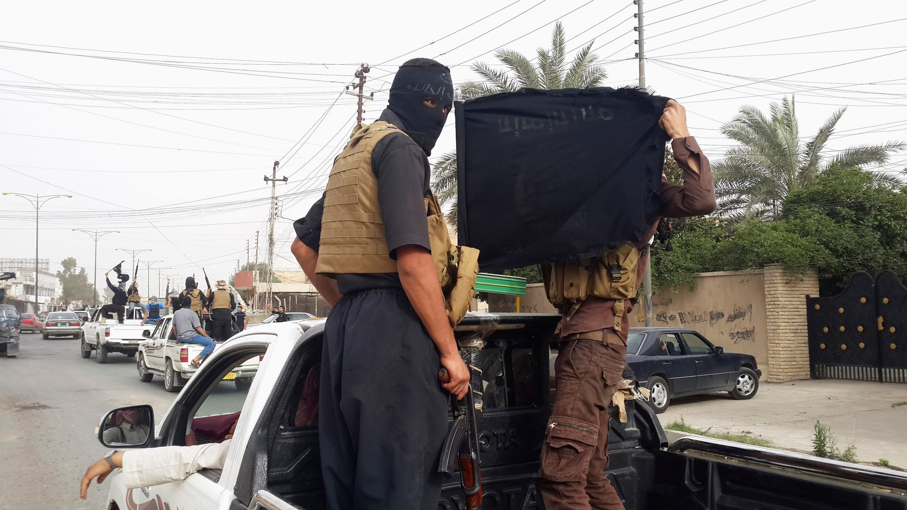 June 12, 2014: ISIS fighters in Mosul, Iraq. (Reuters)