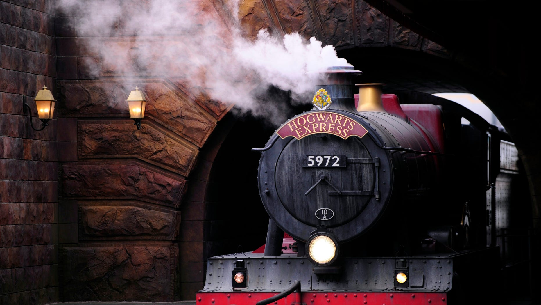 The Hogwarts Express train, which connects the Universal Studios with neighboring Islands of Adventure, pulls into the Hogsmeade Station during a media preview for The Wizarding World of Harry Potter-Diagon Alley at the Universal Orlando Resort in Orlando, Florida June 19, 2014.