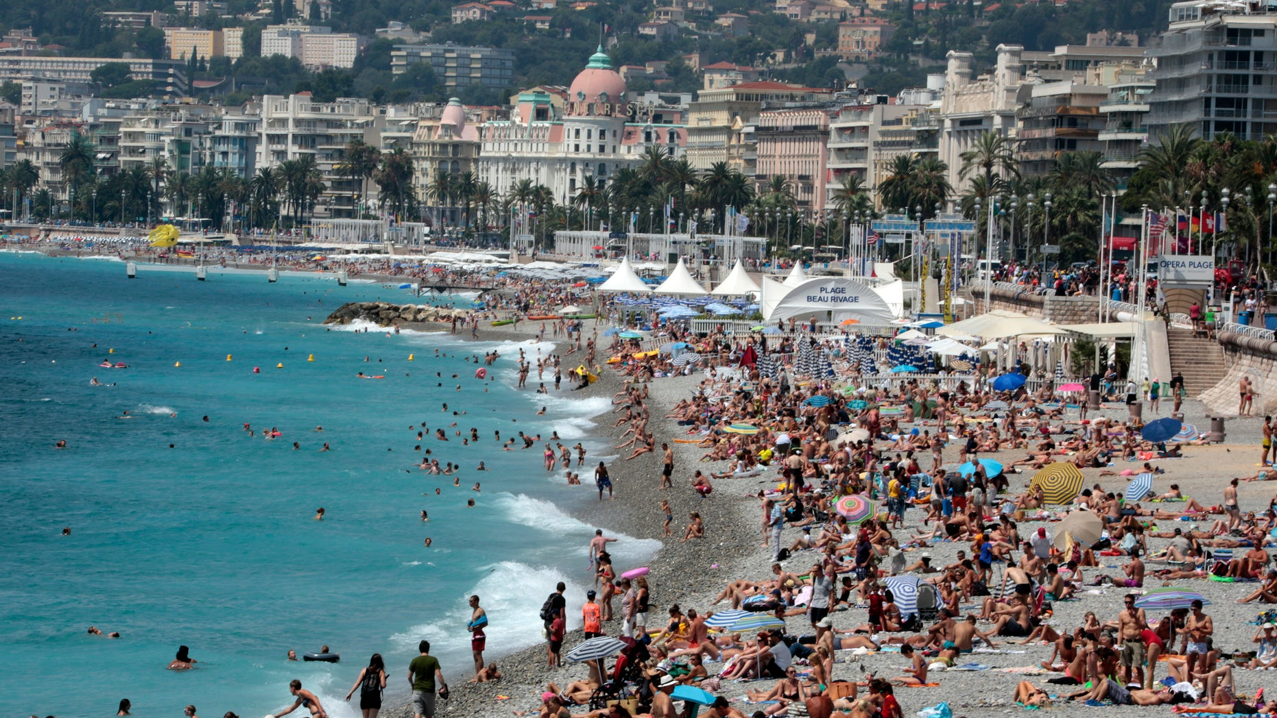 July 28, 2014: Tourists on a beach in Nice, southeastern France. (Reuters)