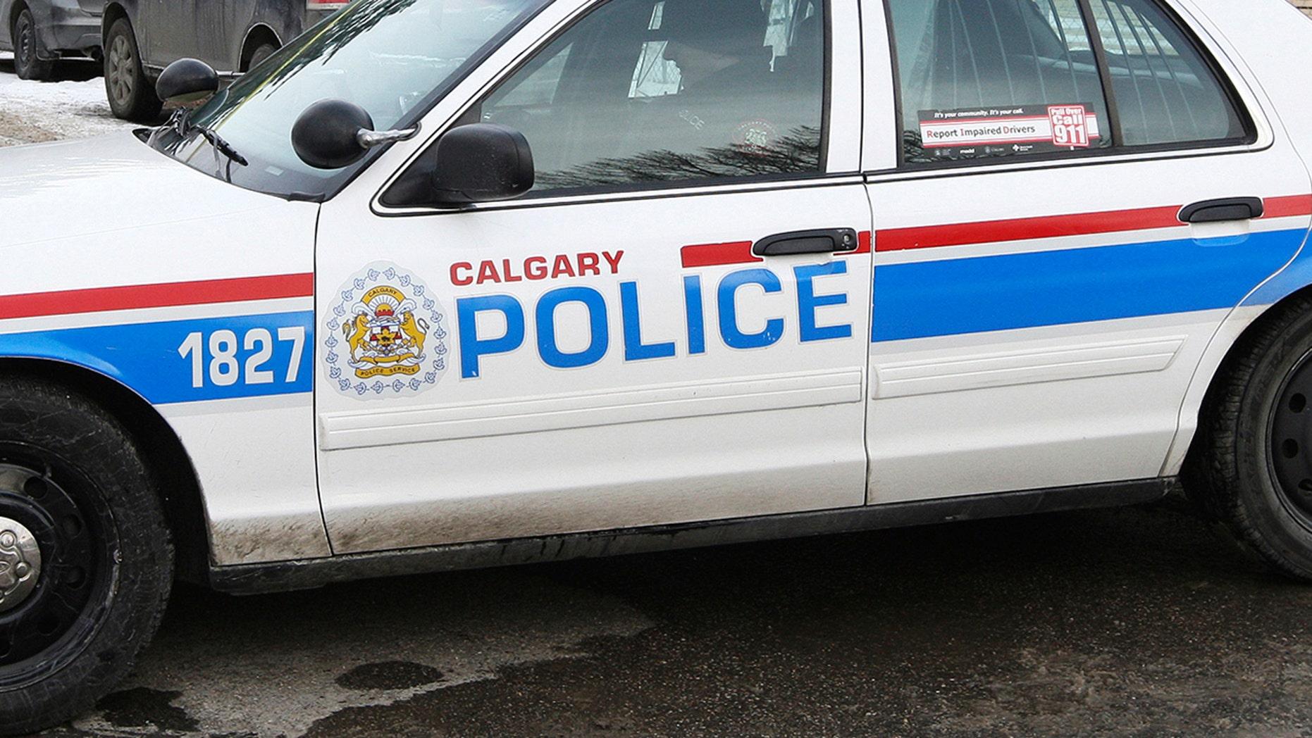 Calgary police said a man's body was found lodged behind a wall in a women's public bathroom.