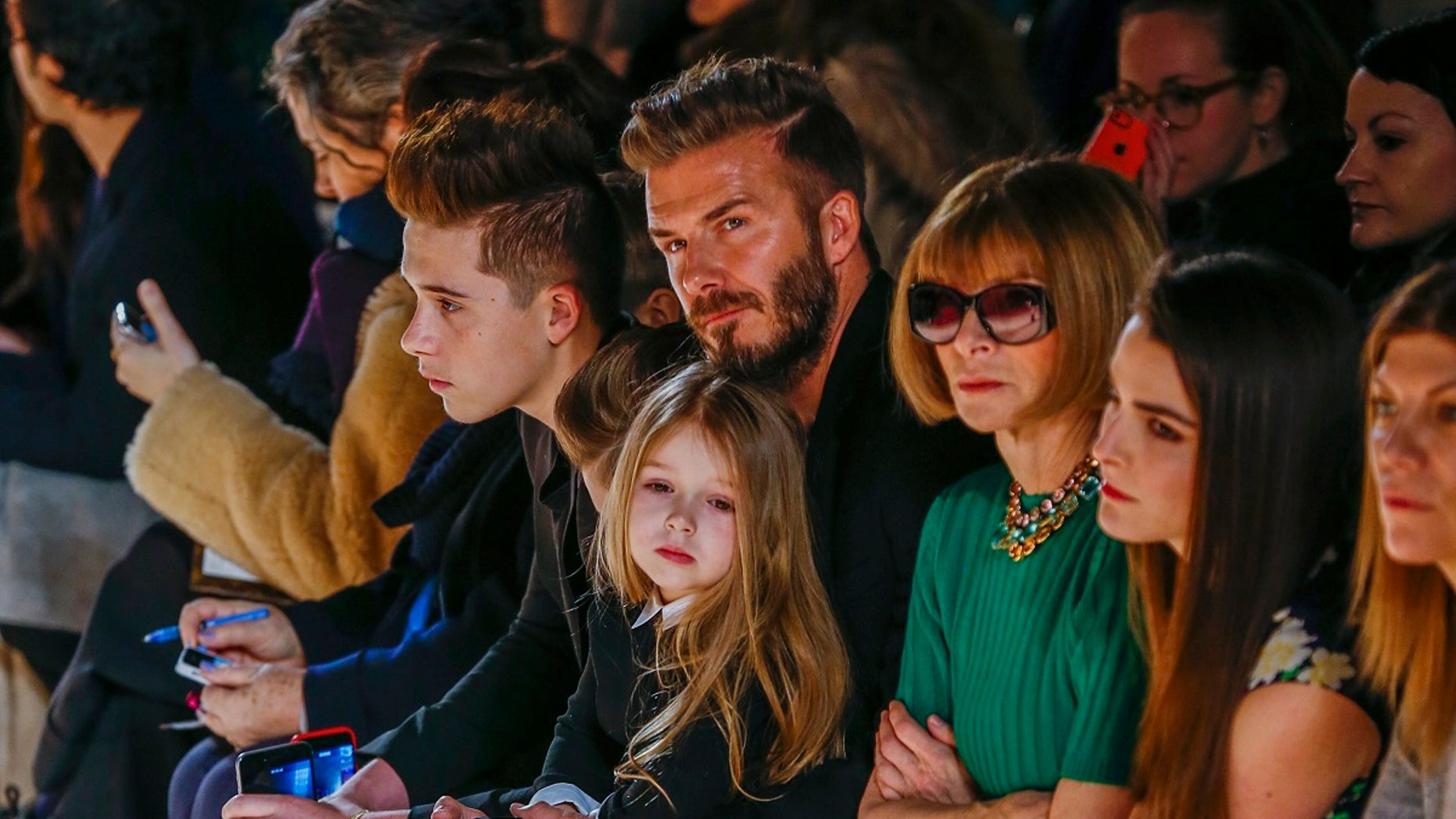 David Beckham with daughter, Harper, at New York Fashion Week event. (Reuters)