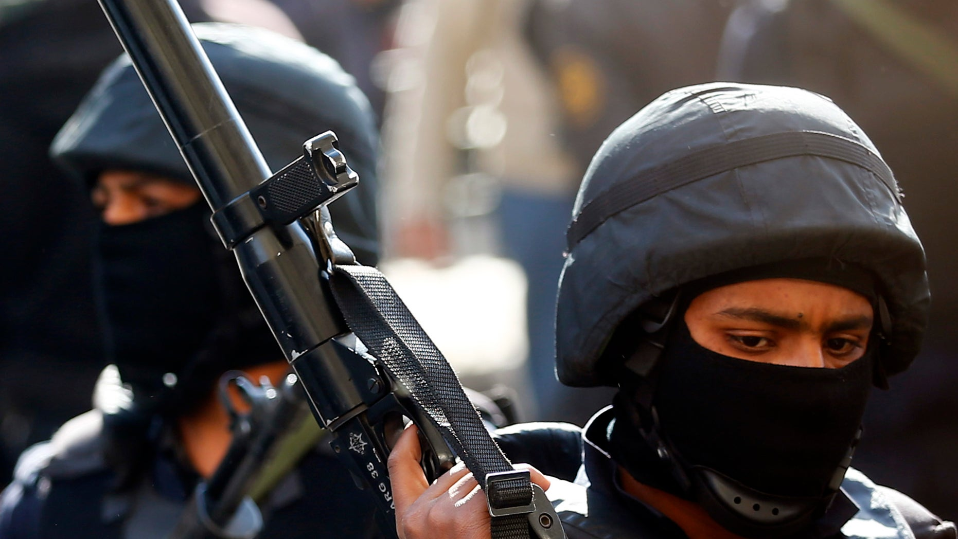 Egyptian police in protective gear.
