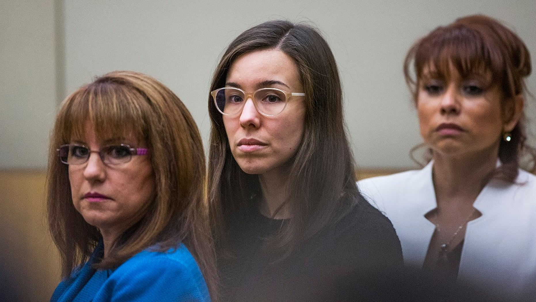 Jodi Arias, center, watches the jury enter the courtroom for her sentencing phase retrial in Phoenix, March 5, 2015.