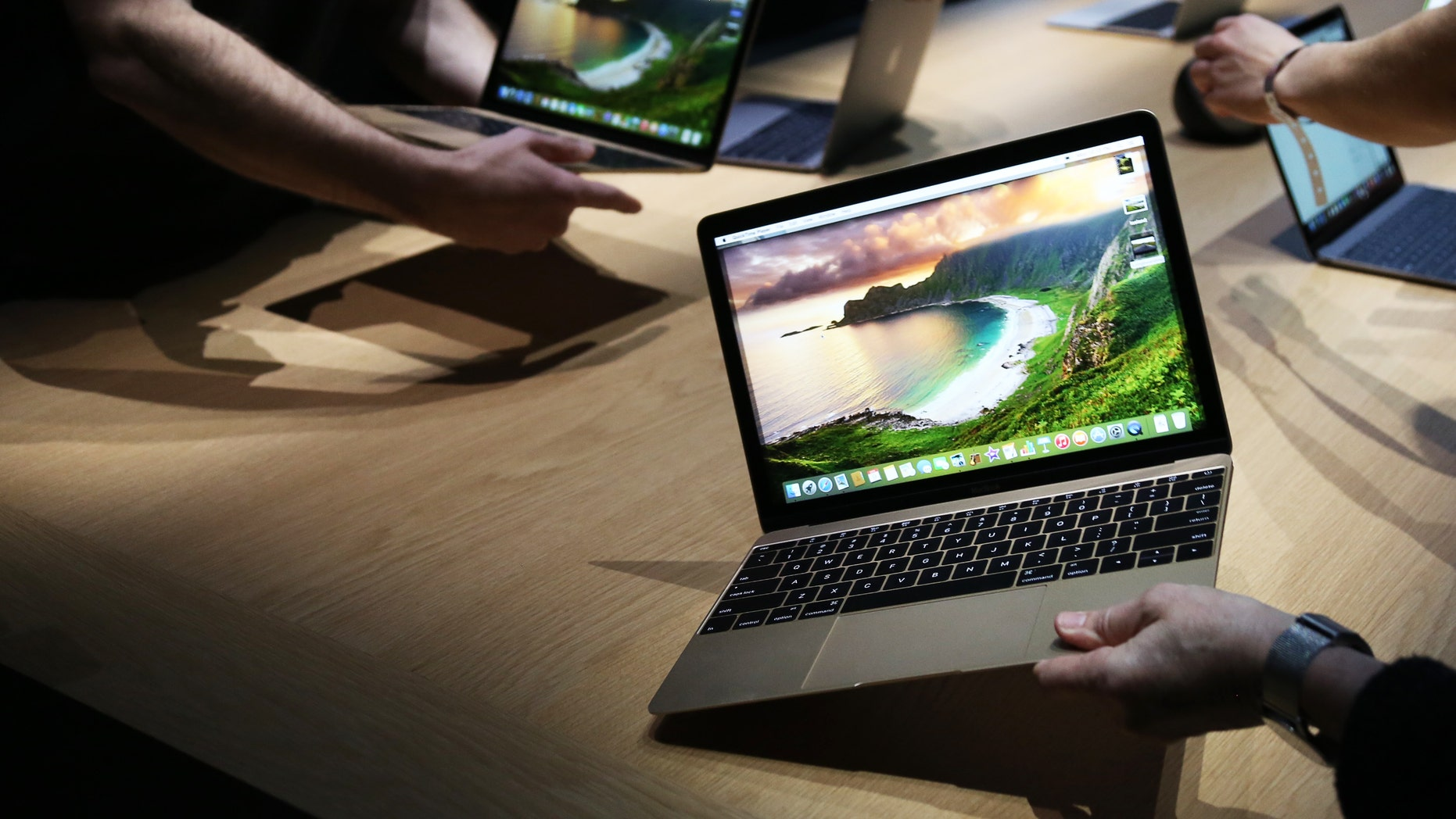 Apple's new MacBooks are displayed following an Apple event in San Francisco, California March 9, 2015.