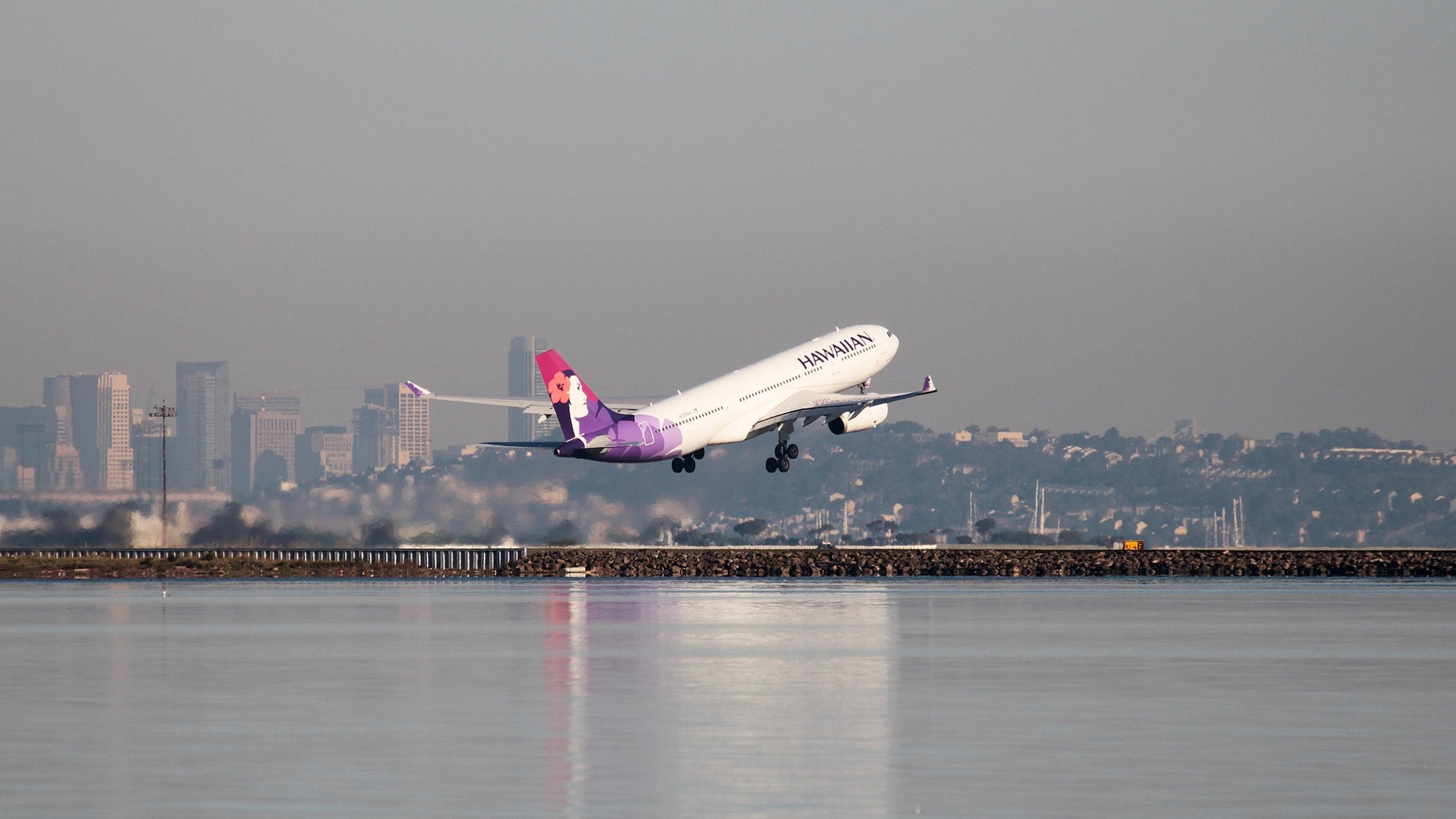 """A file photo of a Hawaiian Airlines flight departing. The airline managed to take passengers """"back in time"""" after a flight leaving New Zealand on Monday arrived in Hawaii on Sunday due to the time difference."""
