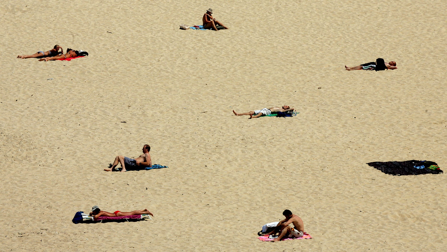 Beachgoers lie on Sydney's Bronte Beach on the hottest October day ever recorded October 13, 2004. The city reached a temperature of 37.9 degrees Celcius (100.2 degrees Fahrenheit), which beat the old mark of 37.4 degrees Celcius (99.3 degrees Fahrenheit) set in 1942.