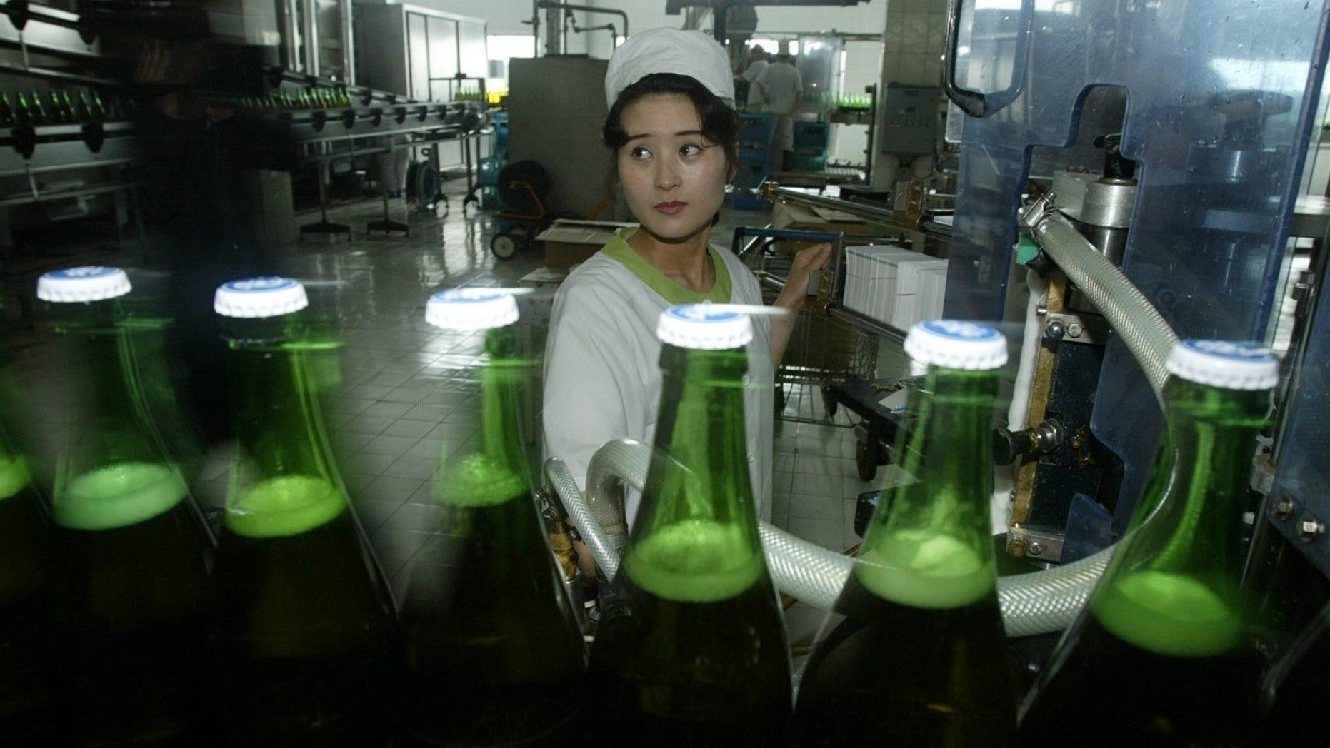 North Korean women work at the Taedonggang Beer factory in 2008.