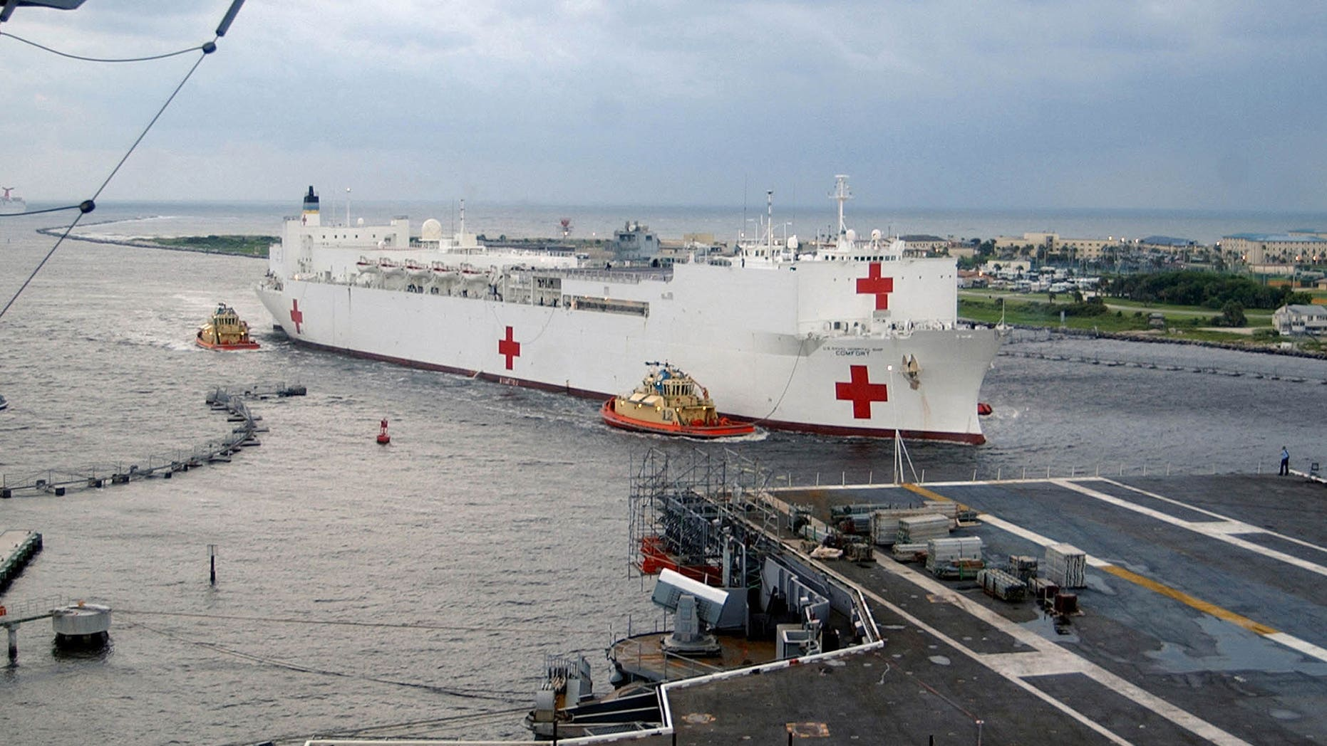 The Military Sealift Command (MSC) hospital ship USNS Comfort (T-AH 20) pulls into Naval Station Mayport, Florida, September 5, 2005, to take on supplies on their way to aid victims of Hurricane Katrina. The Navy's involvement in the Hurricane Katrina humanitarian assistance operations is led by the Federal Emergency Management Agency in conjunction with the Department of Defense.