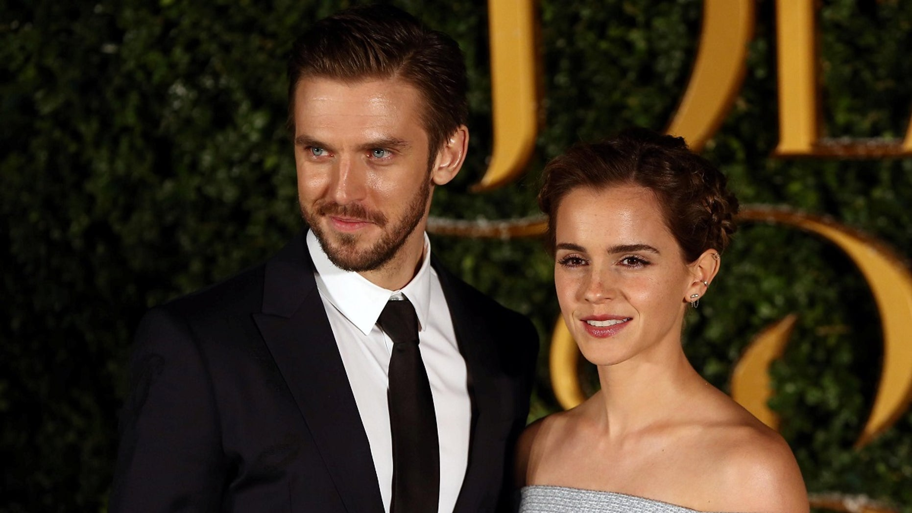 """Dan Stevens and Emma Watson pose for photographers at a media event for the live action film """"Beauty and the Beast"""" in London, Britain."""
