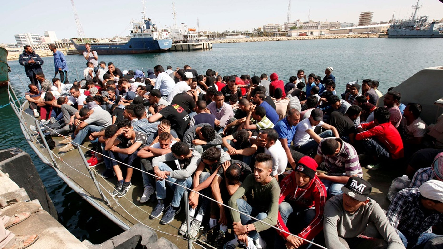 Illegal migrants arrive by boat at a naval base after they were rescued by Libyan coastguard in the coastal city of Tripoli, Libya, May 10, 2017.