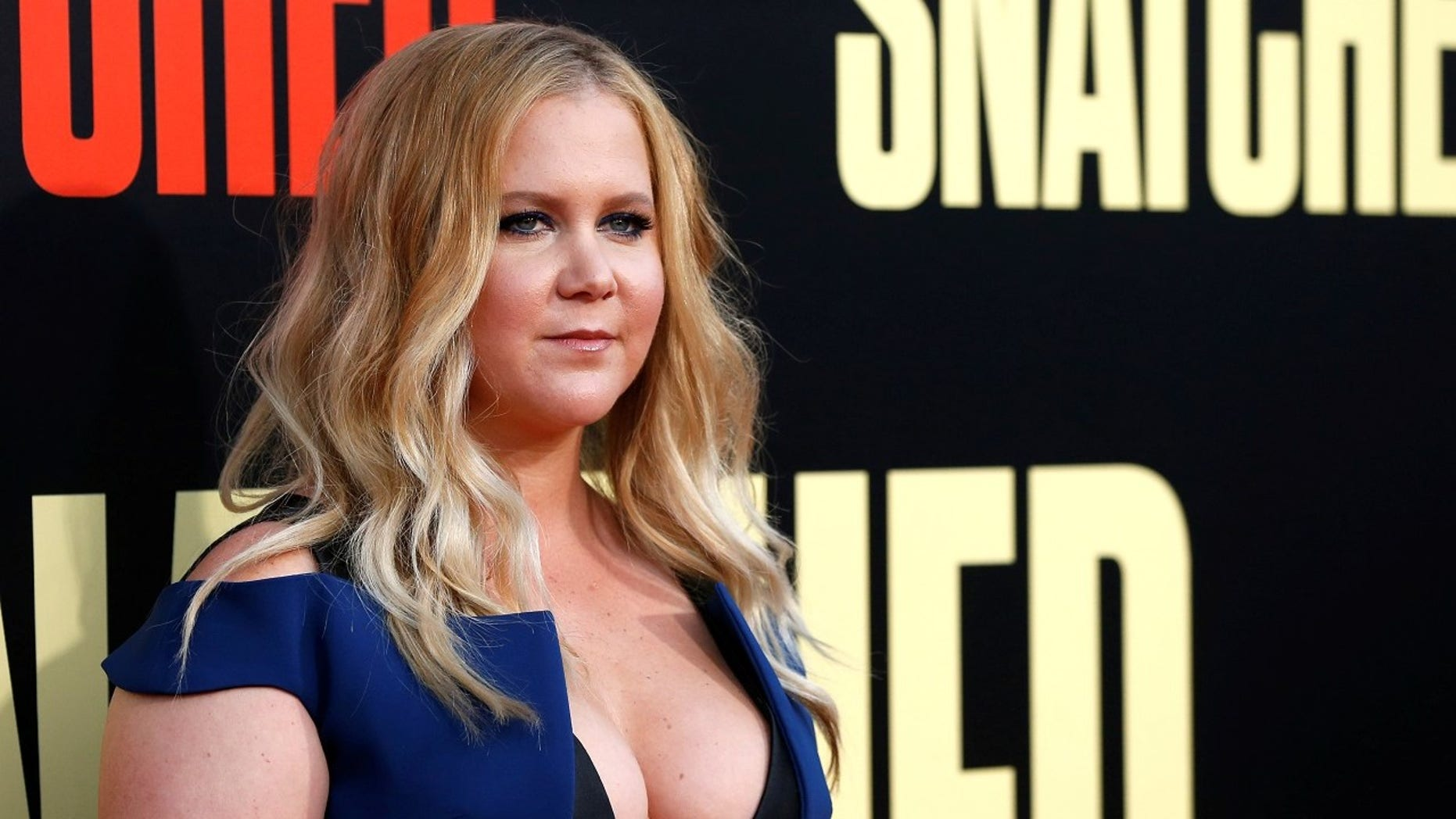 Amy Schumer revealed that she's pregnant with husband Chris Fisher