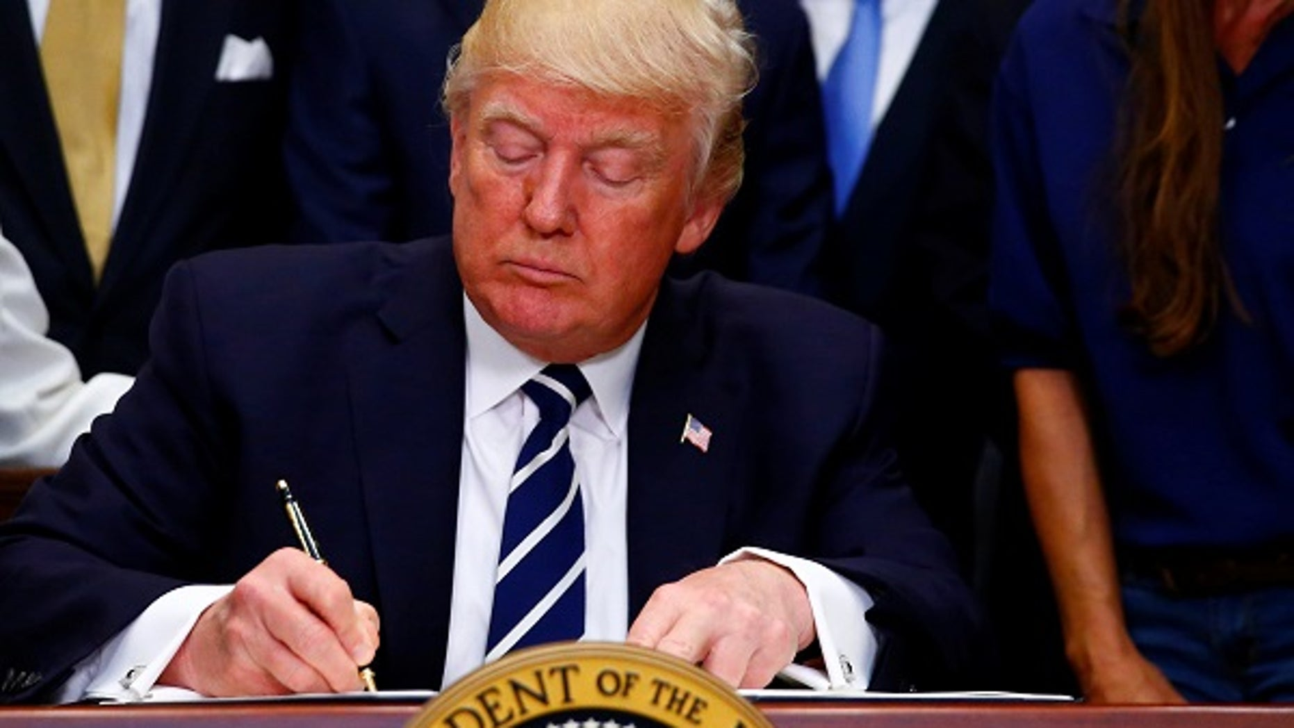 """U.S. President Donald J. Trump delivers remarks on """"Apprenticeship and Workforce of Tomorrow"""" initiatives and signs an executive order at the White House in Washington, U.S. June 15, 2017. REUTERS/Eric Thayer - RTS178NS"""