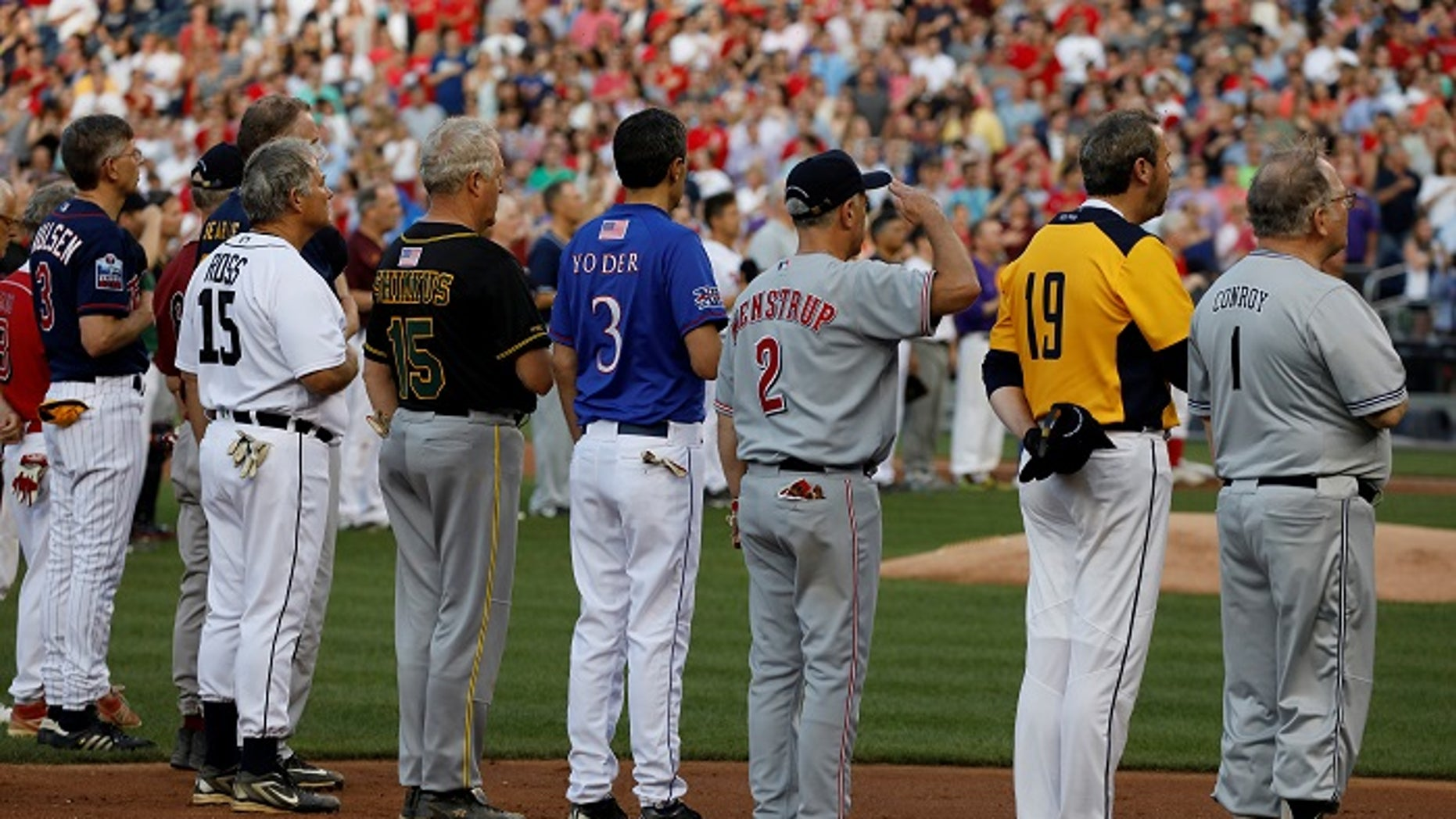 Members of the Congressional baseball teams stand for the National Anthem during the Congressional Baseball Game at Nationals Park in Washington, U.S., June 15, 2017.