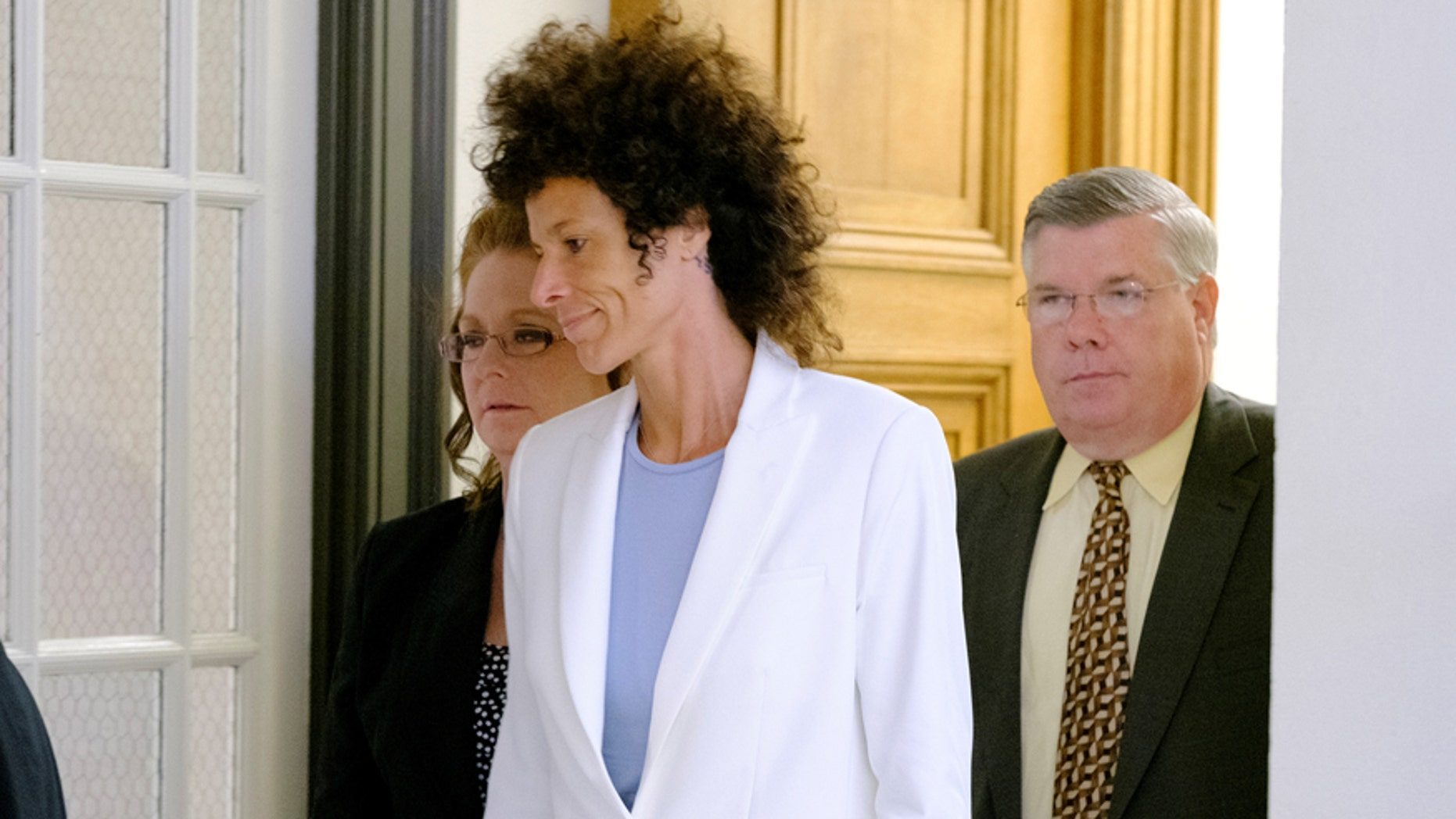 Bill Cosby accuser Andrea Constand leaves after the judge declared a mistrial in Cosby's sexual assault trial at the Montgomery County Courthouse in Norristown, Pennsylvania, U.S. June 17, 2017. REUTERS/Ed Hille/Pool - RTS17HDL