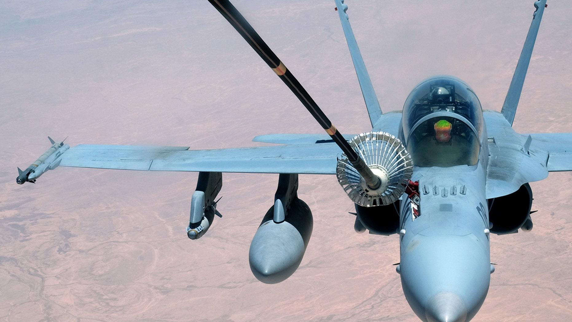 A F-18 Super Hornet receives fuel.