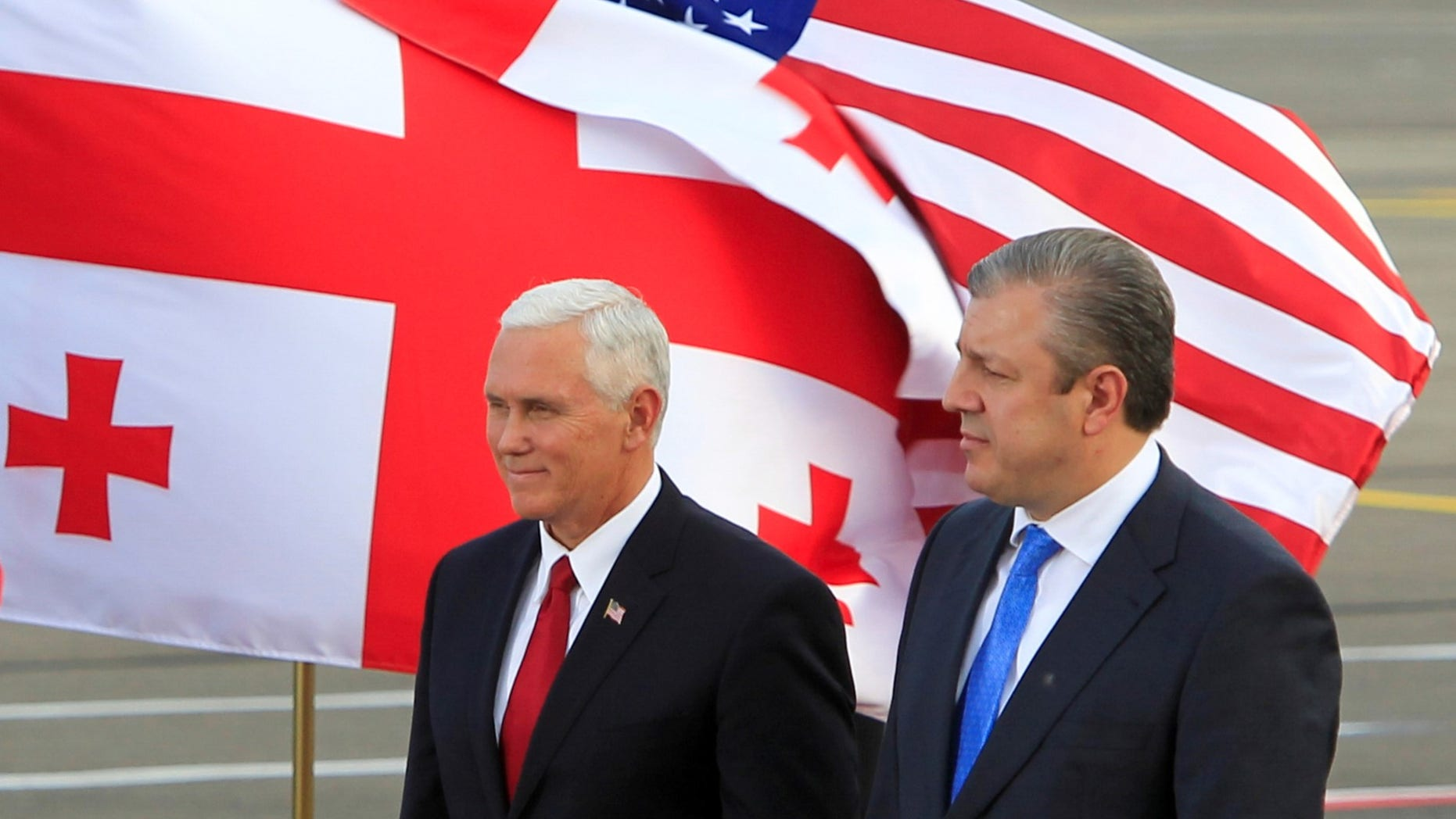 FILE -- Vice President Mike Pence and Georgian Prime Minister Georgi Kvirikashvili attend a welcoming ceremony at the Tbilisi International Airport, Georgia July 31, 2017.