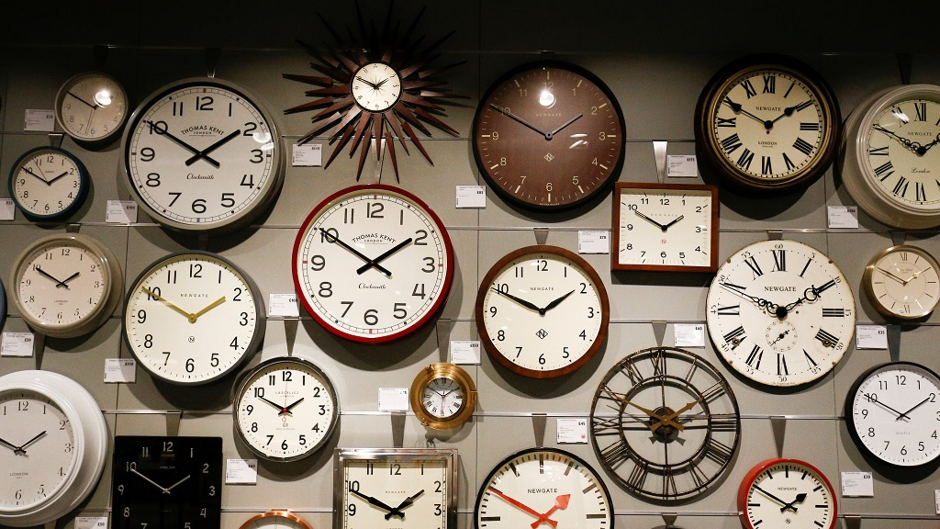 Clocks are displayed inside the new John Lewis store at the Westfield shopping centre in White City, London, Britain, March 19, 2018.